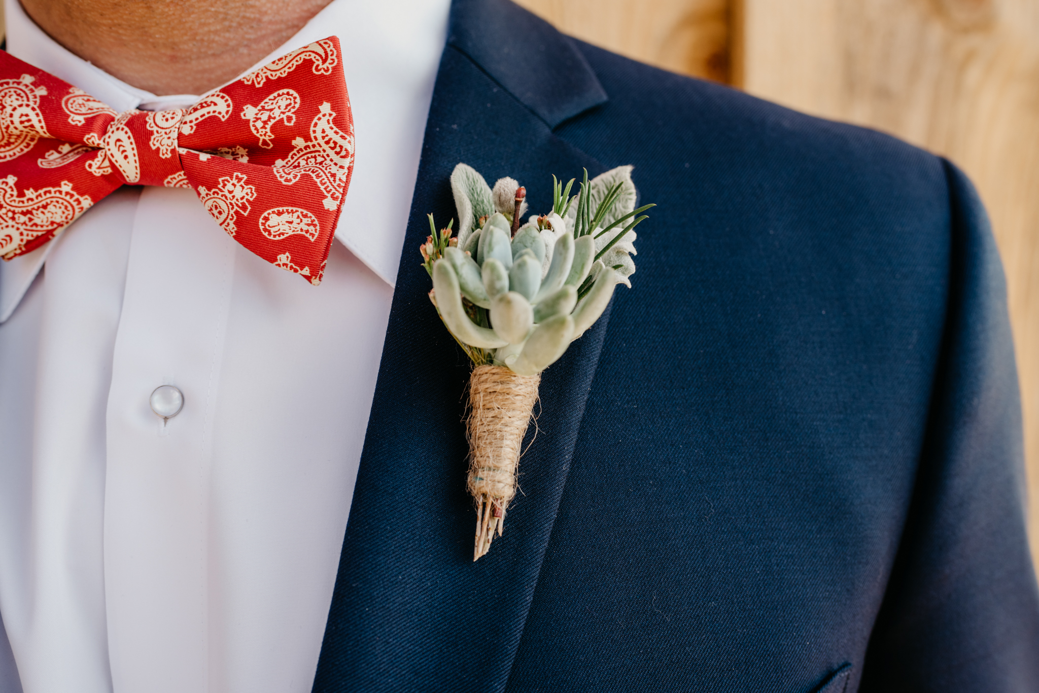 A close up of one of the grooms' boutonniere at their styled engagement session with Rose Trail Images at Windy Hill Farm near Raleigh, NC.