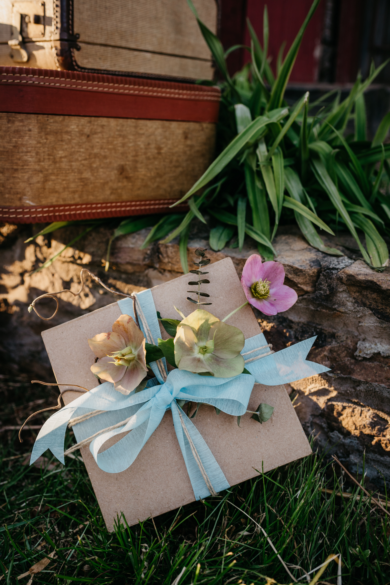 The suitcases and gifts were setup outside by the barn at the rustic styled engagement session with Rose Trail Images at Windy Hill Farm near Raleigh, NC.