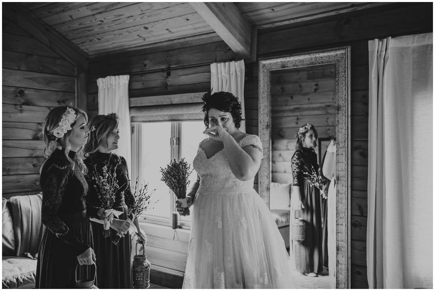 The bride having a moment with her bridesmaids before her wedding day at the Barn at Valhalla in Chapel Hill, taken by Rose Trail Images.