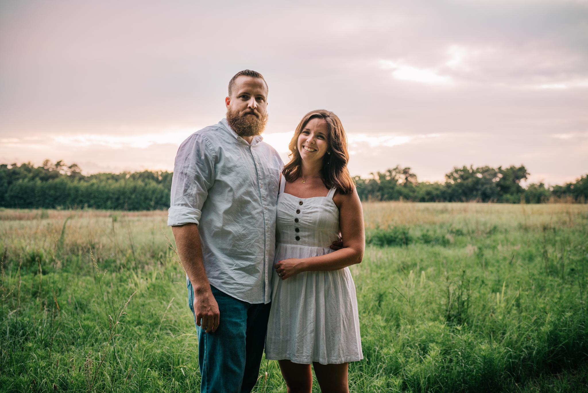 The couple pose at sunset for their engagement pictures with Rose Trail Images at Horseshoe Park in Wake Forest, North Carolina.