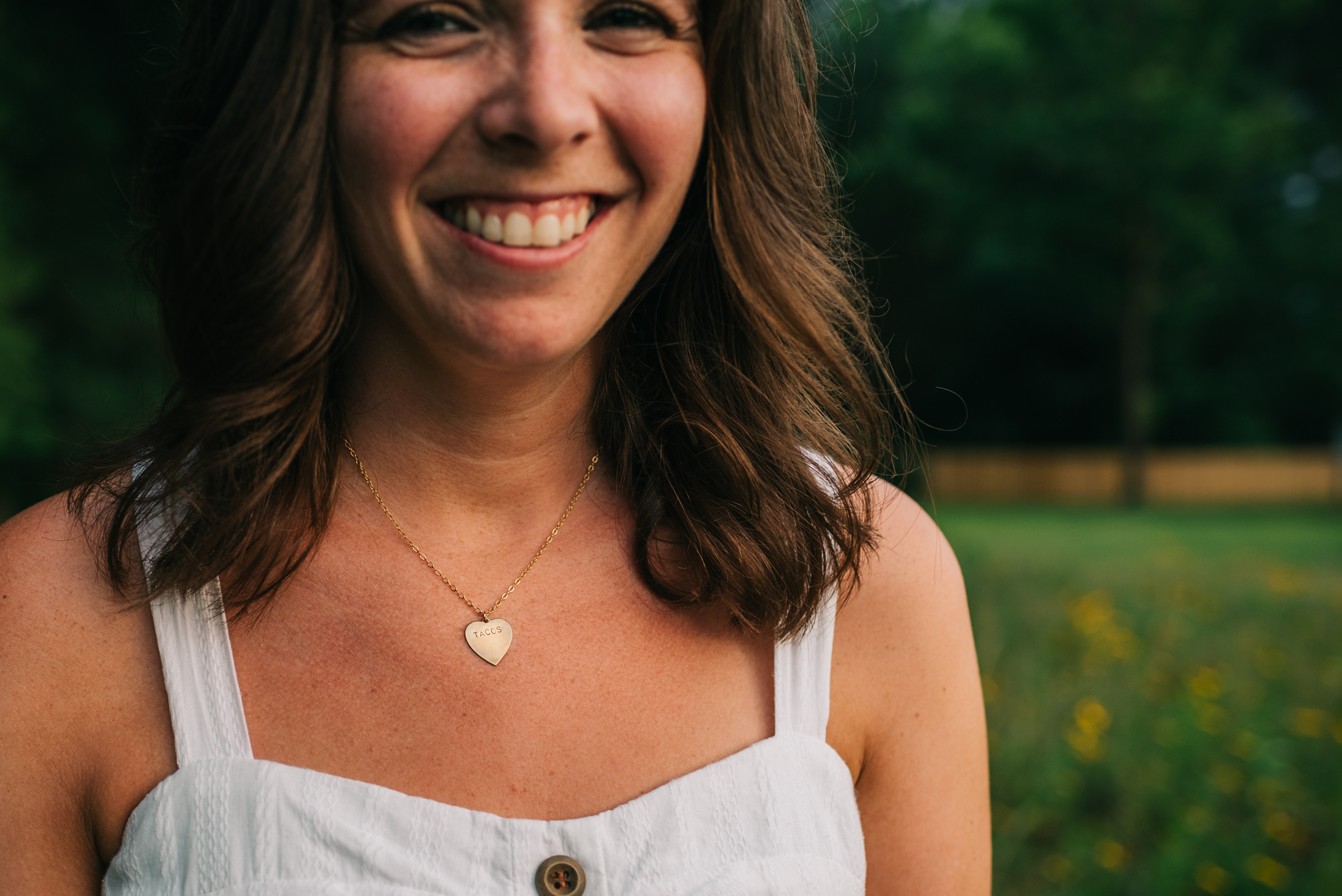 The bride wore a tacos necklace during her engagement pictures with Rose Trail Images at Horseshoe Park in Wake Forest, North Carolina.