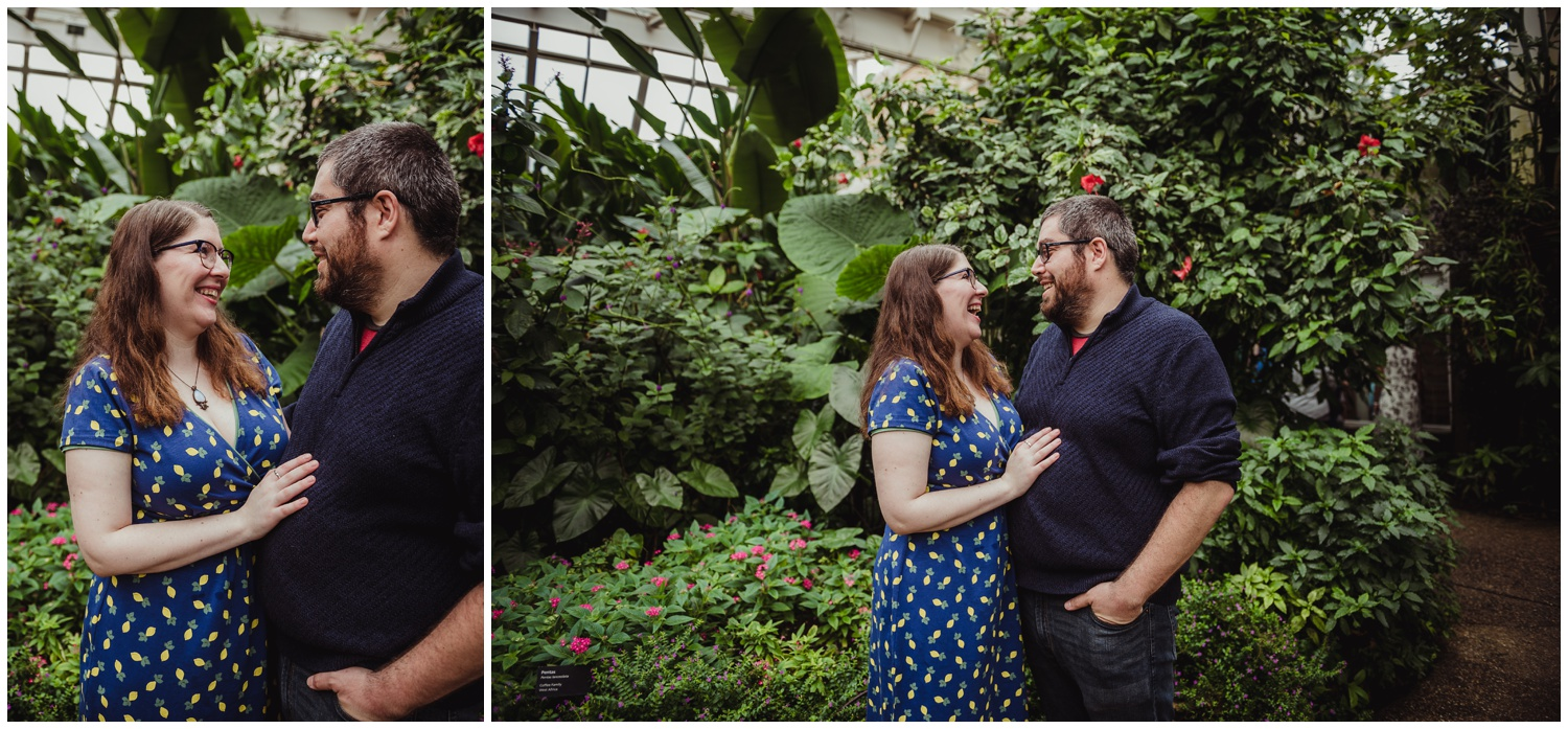 The couple share a laugh in the Butterfly House during their engagement photo session with Rose Trail Images in Durham, NC.