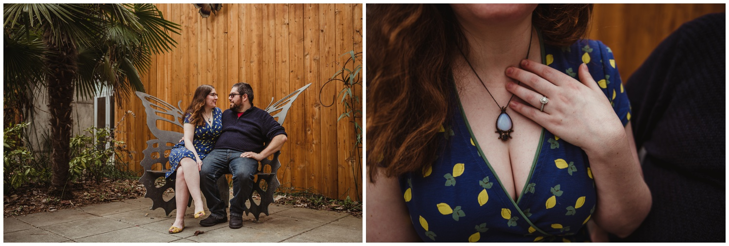 The couple sit on a butterfly bench outside the Butterfly House during their engagement photo session with Rose Trail Images in Durham, NC.