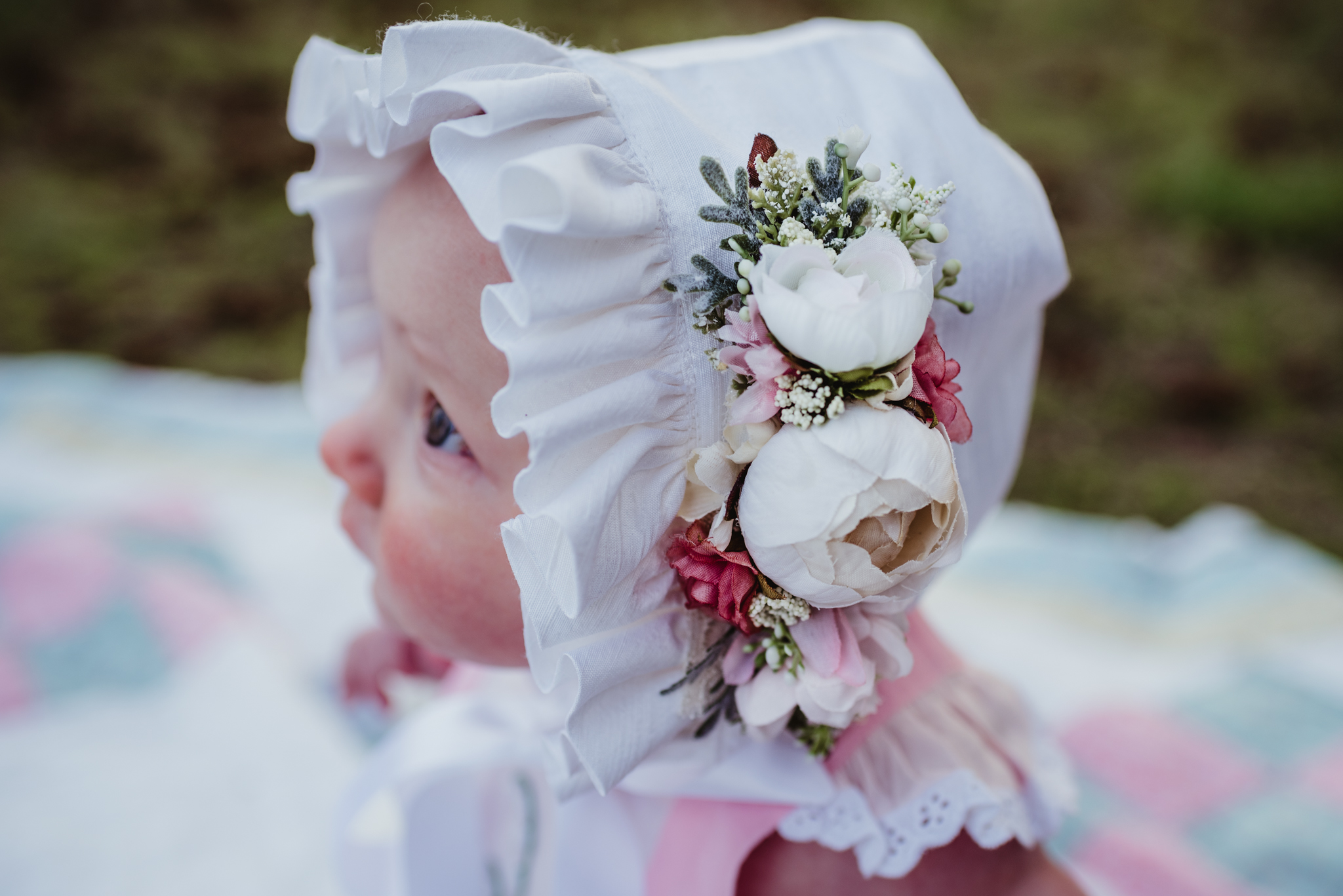 A close up of the baby's Easter bonnet during their family photos with Rose Trail Images at Horseshoe Farm Park in Wake Forest, NC.