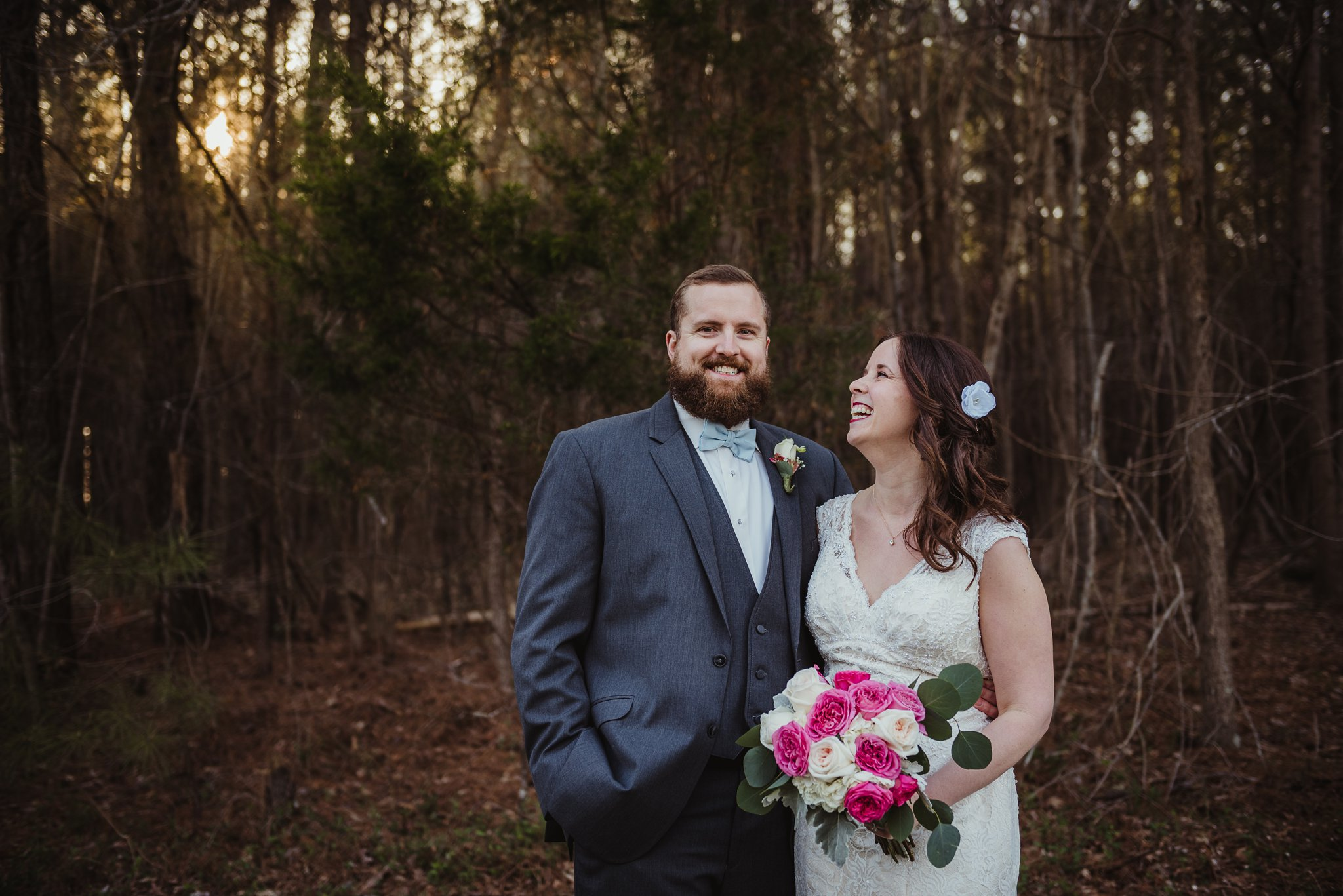 The bride and groom have their portraits taken by Rose Trail Images at their wedding venue in Oxford , NC called Carlee Farms.