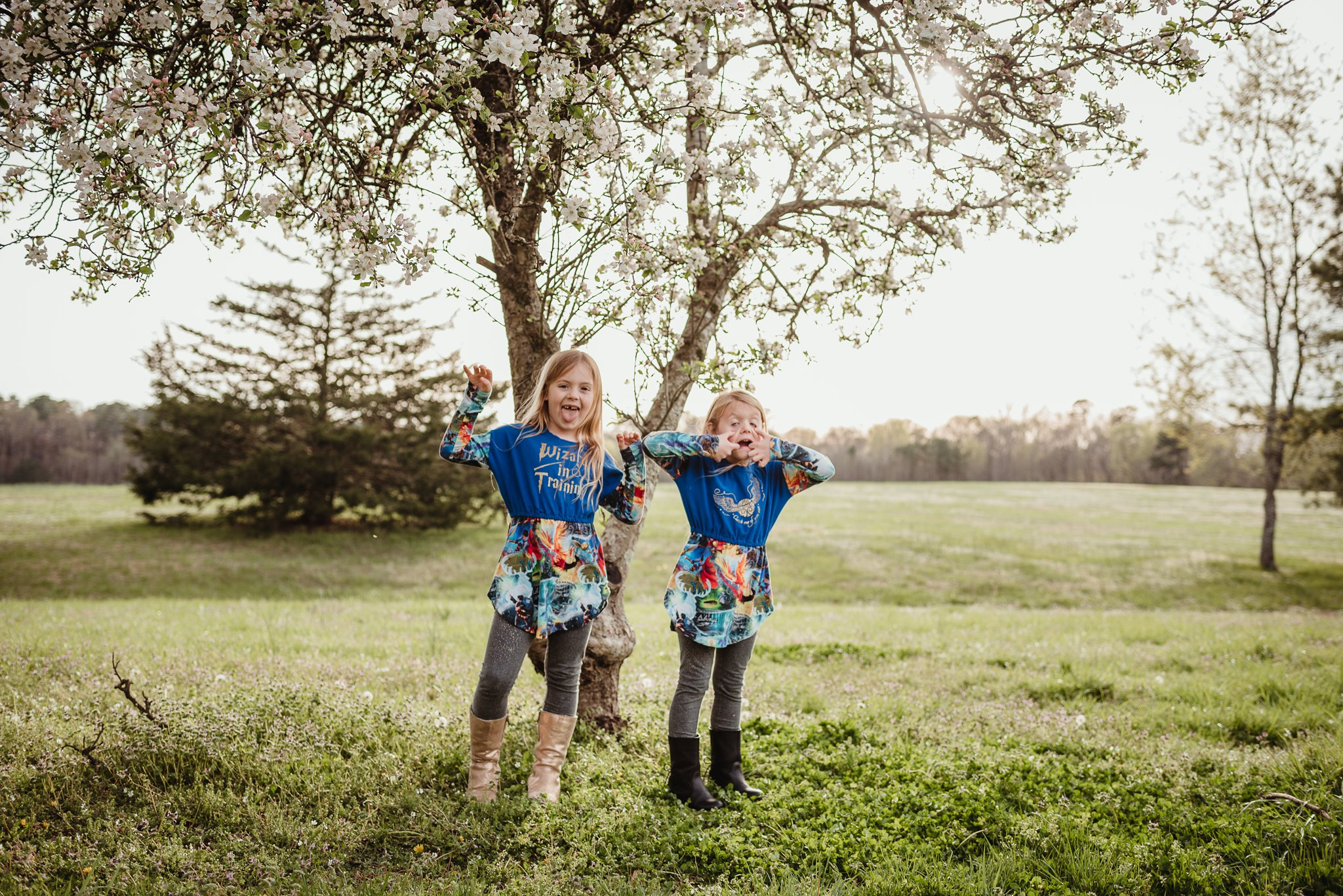 These sisters got silly for the camera with Rose Trail Images during their family photo session in Wake Forest, North Carolina.
