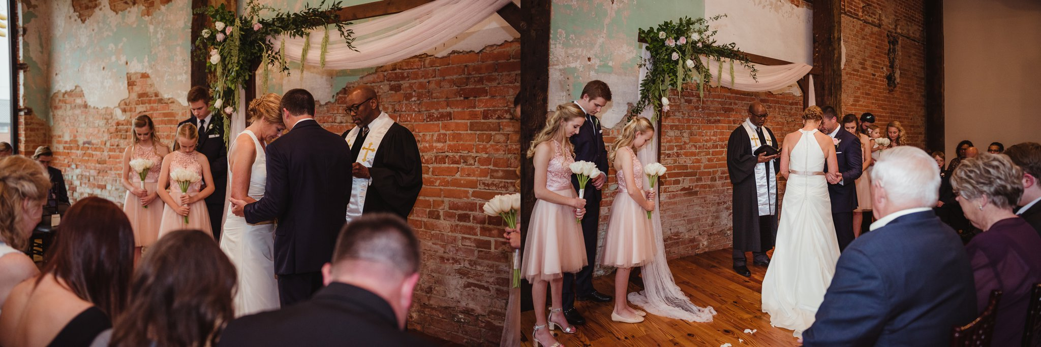The bride and groom, along with their guests, take a moment to pray at their wedding ceremony in Youngsville, NC, images taken by Rose Trail Images.