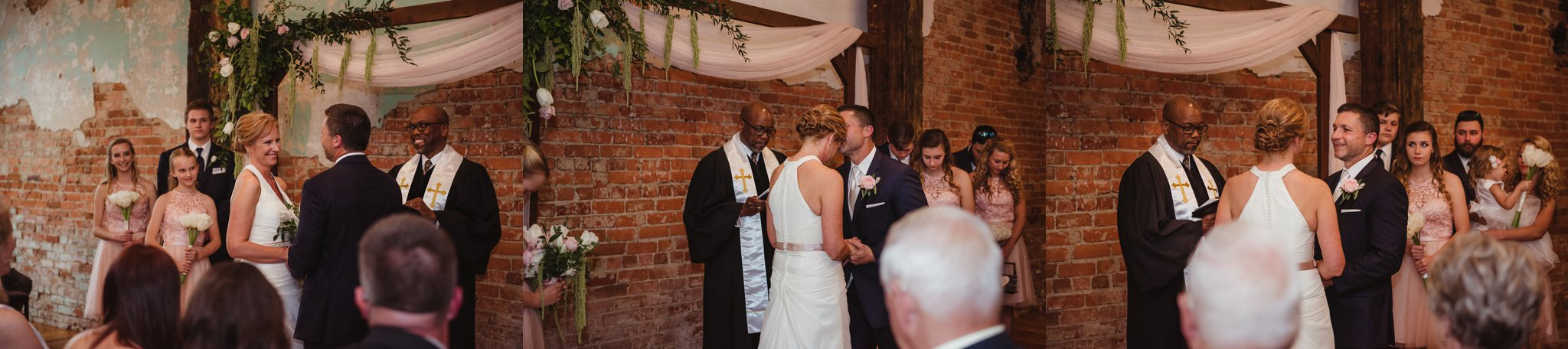 The bride and groom share vows and a sweet forehead kiss at their wedding ceremony in Youngsville, NC, images taken by Rose Trail Images.