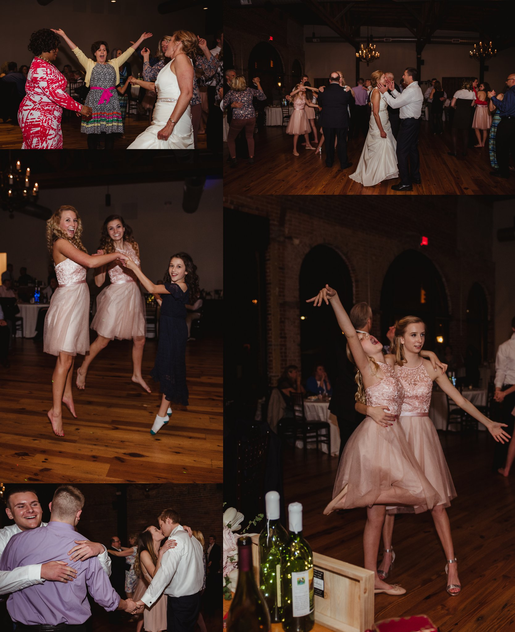 Guests enjoy dancing and jumping for the camera with Rose Trail Images at the wedding reception at Cross and Main in Youngsville, NC.