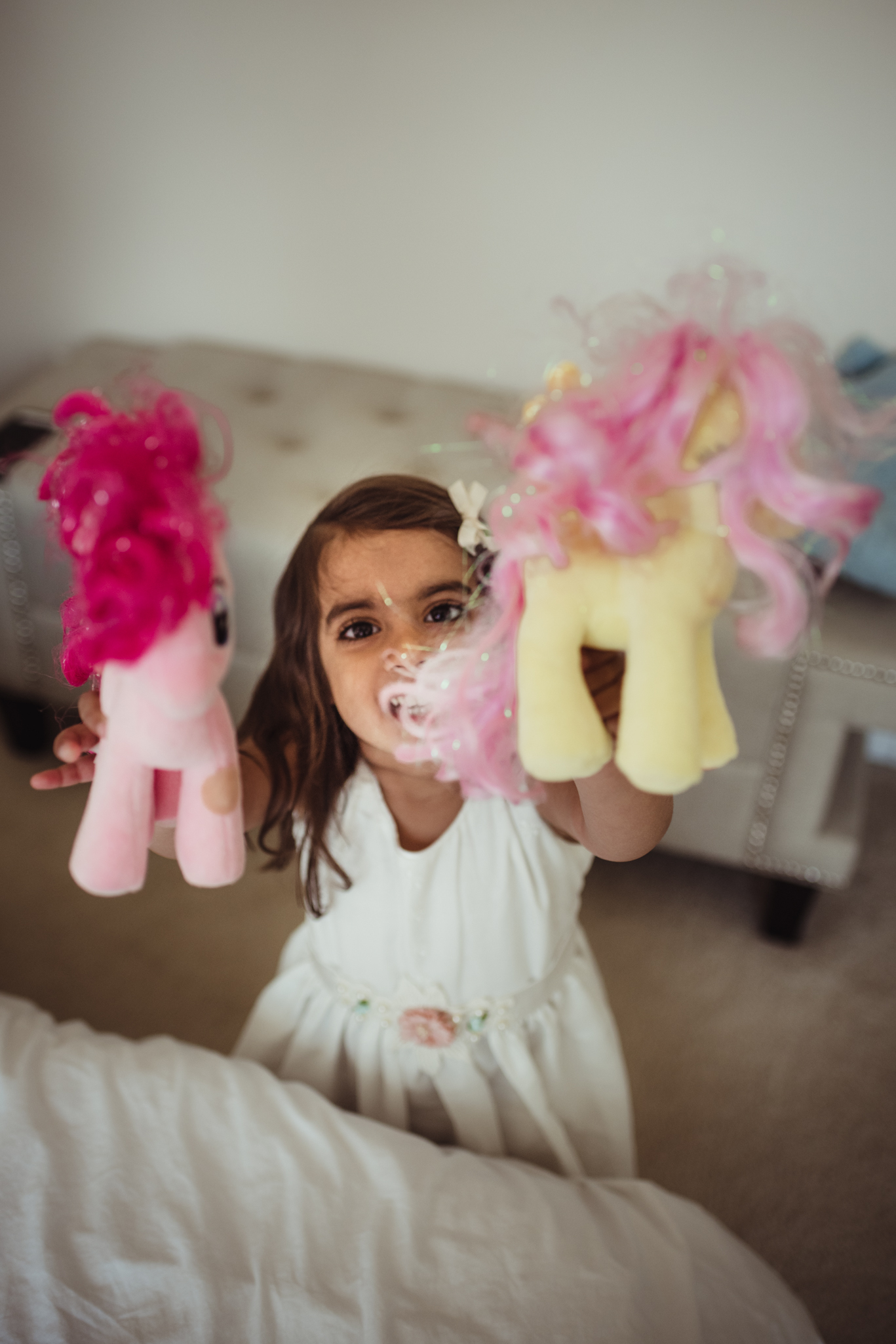 The daughter plays with her My Little Pony dolls during her photo session with Rose Trail Images in Raleigh, North Carolina.