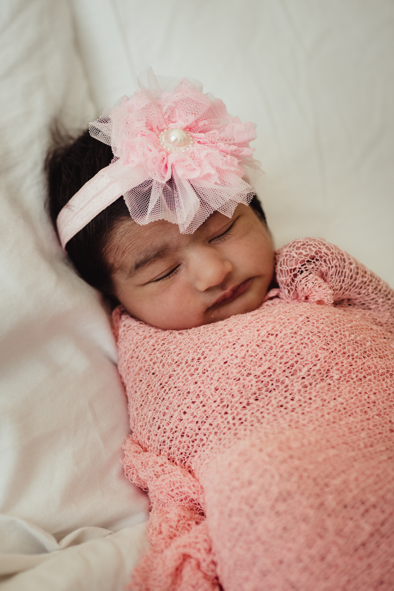 The newborn baby girl sleeps during her lifestyle newborn session with Rose Trail Images in Raleigh, North Carolina.