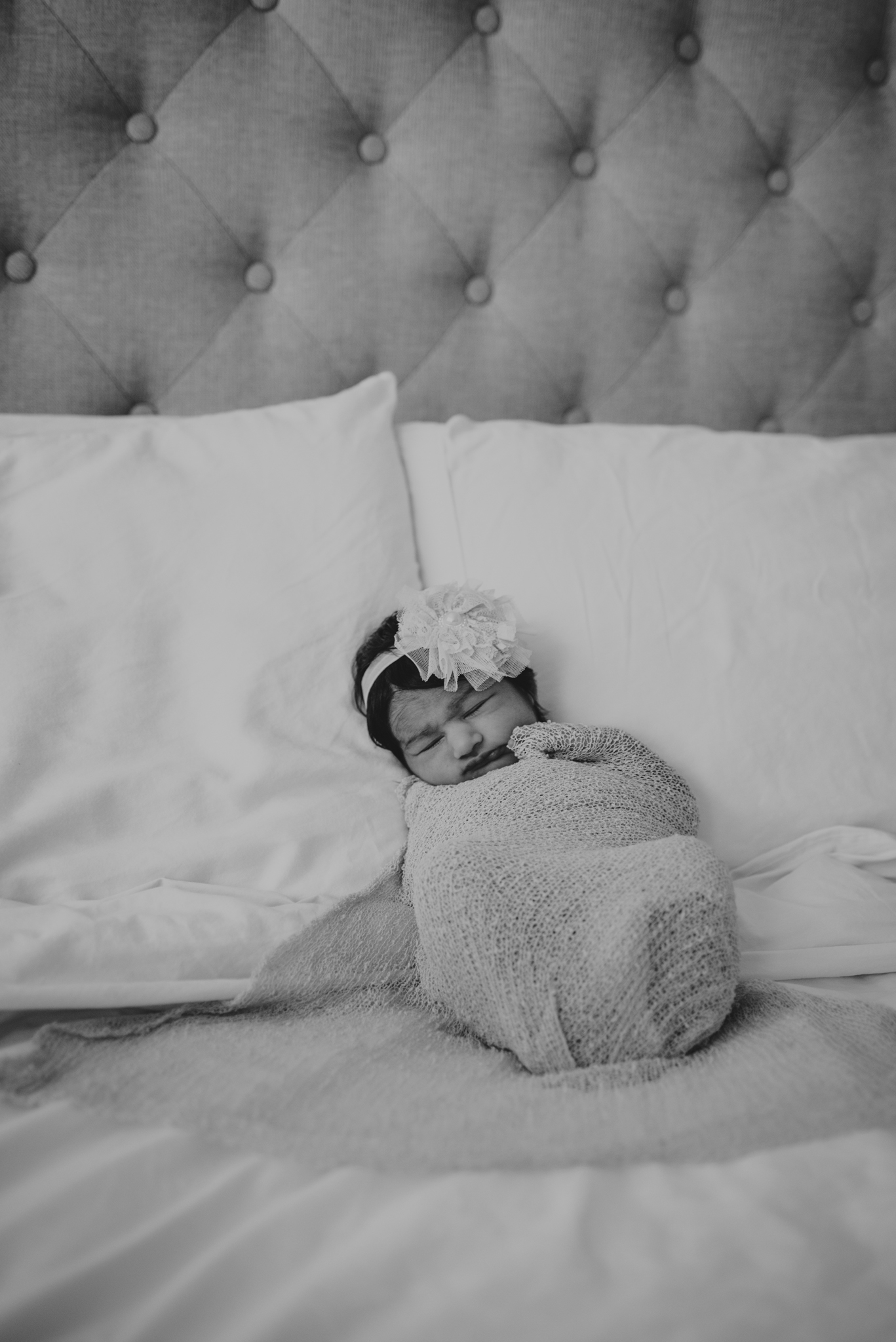 Baby girl Emma sleeps during her lifestyle newborn session with Rose Trail Images in Raleigh, North Carolina.
