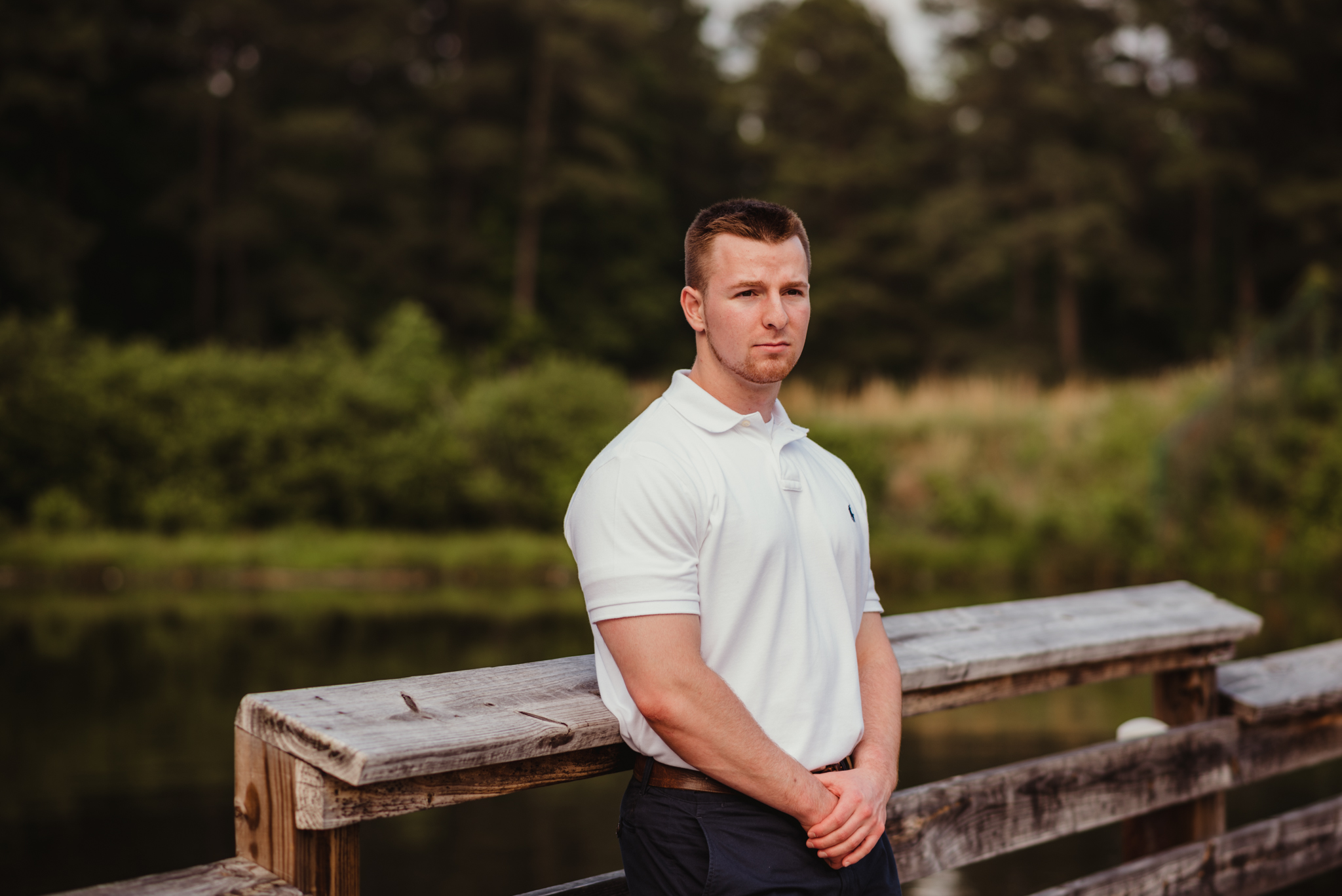 Harrison, standing on the dock, had his senior portraits done at Durant Nature Preserve in Raleigh, NC by Rose Trail Images.