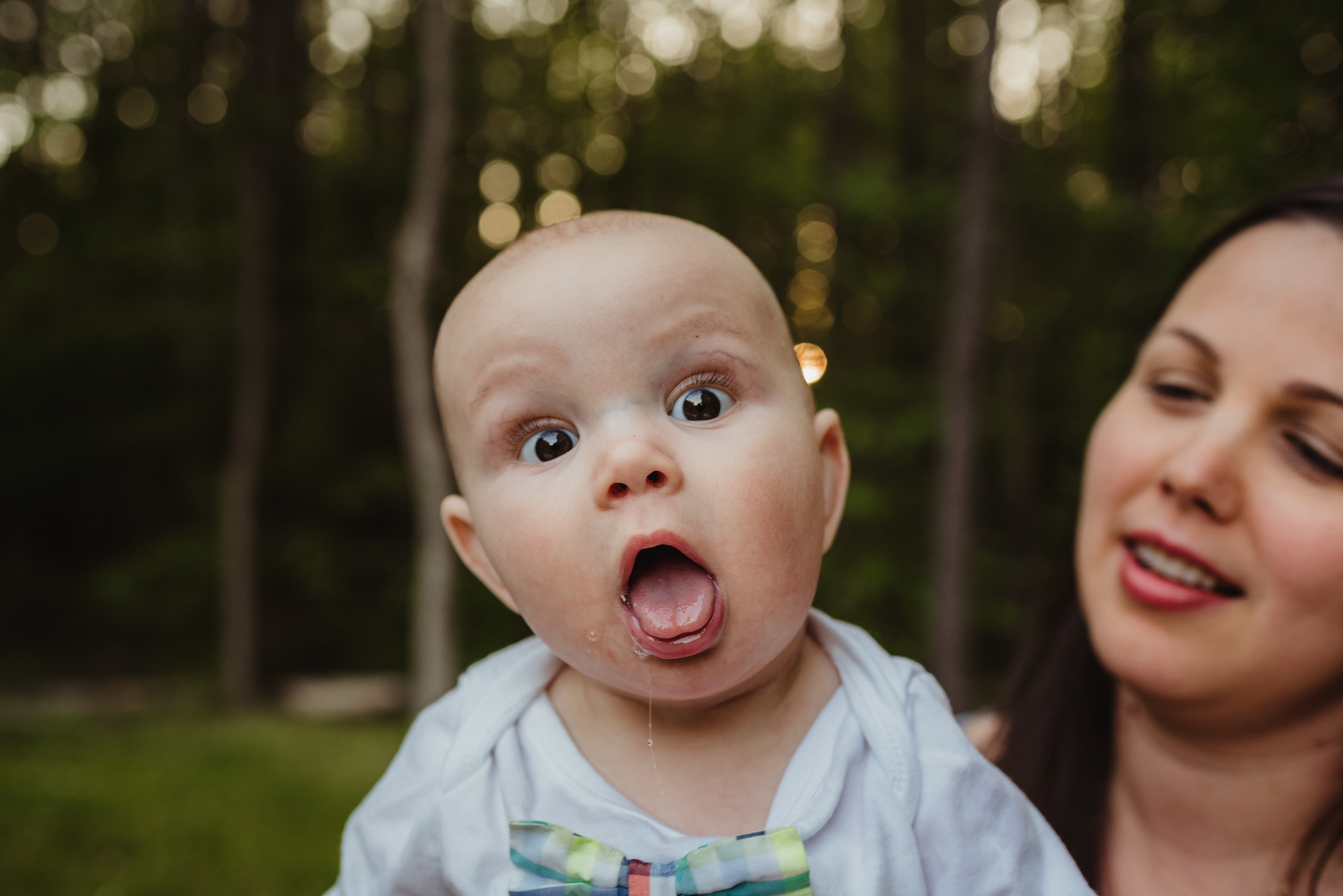Baby makes a super silly face during his family photo session with Rose Trail Images in Rolesville, North Carolina.