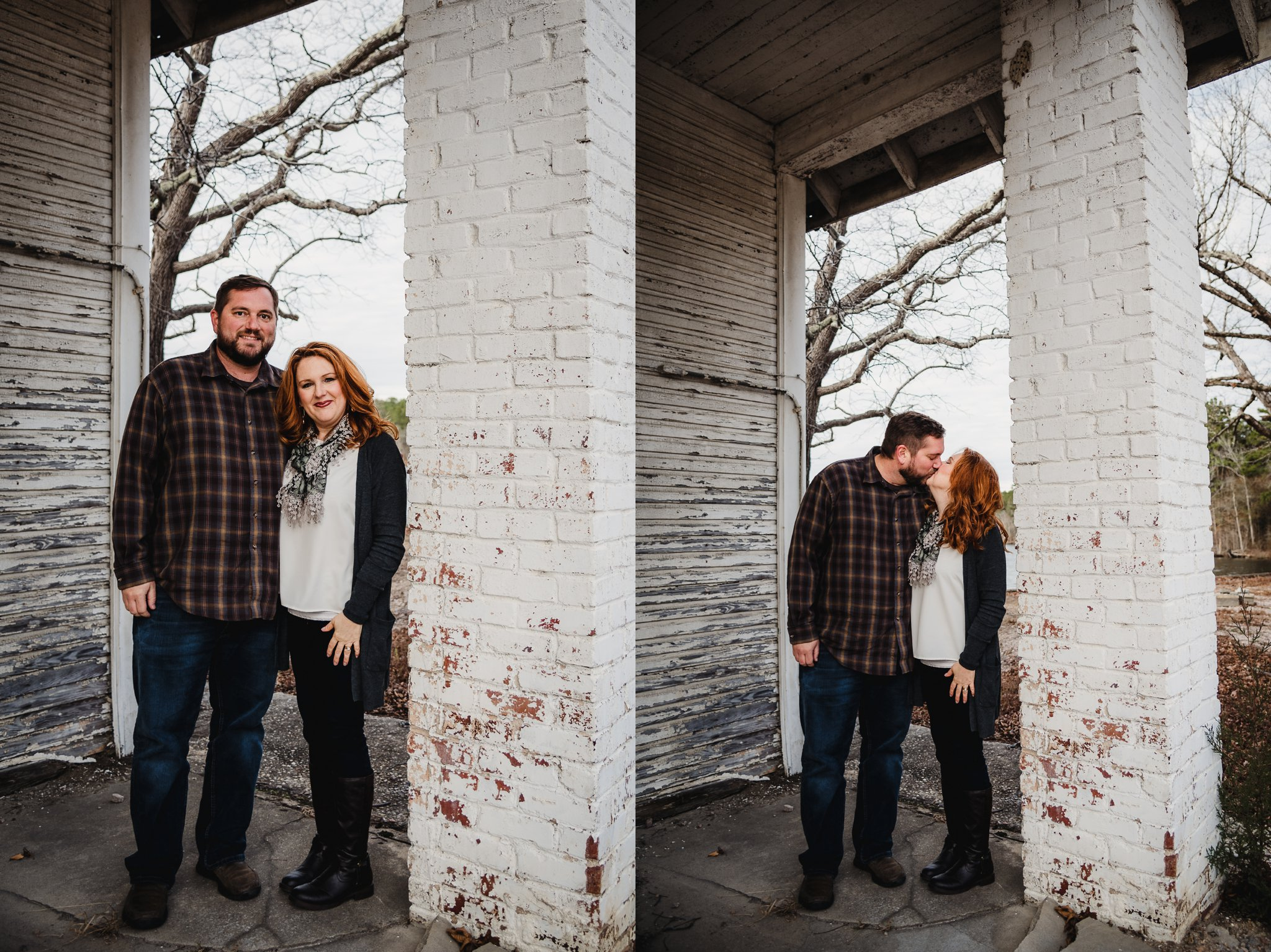 The parents of three kiddos stood in front of an abandoned store front at Lake Myra in Wendell, NC for their family pictures with Rose Trail Images.