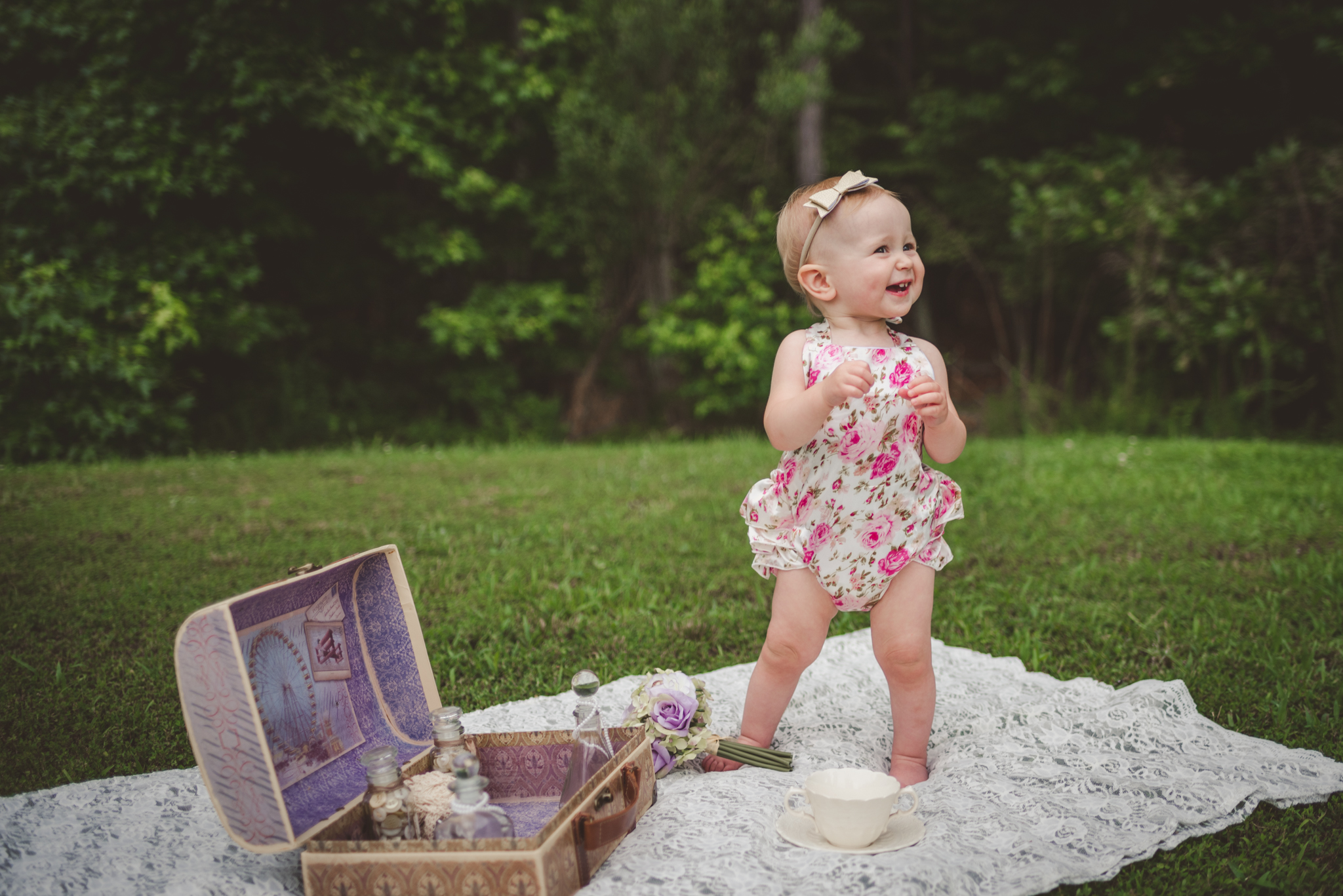 This little girl just starting learning to stand on her own on her first birthday in Rolesville, North Carolina, image taken by Rose Trail Images.