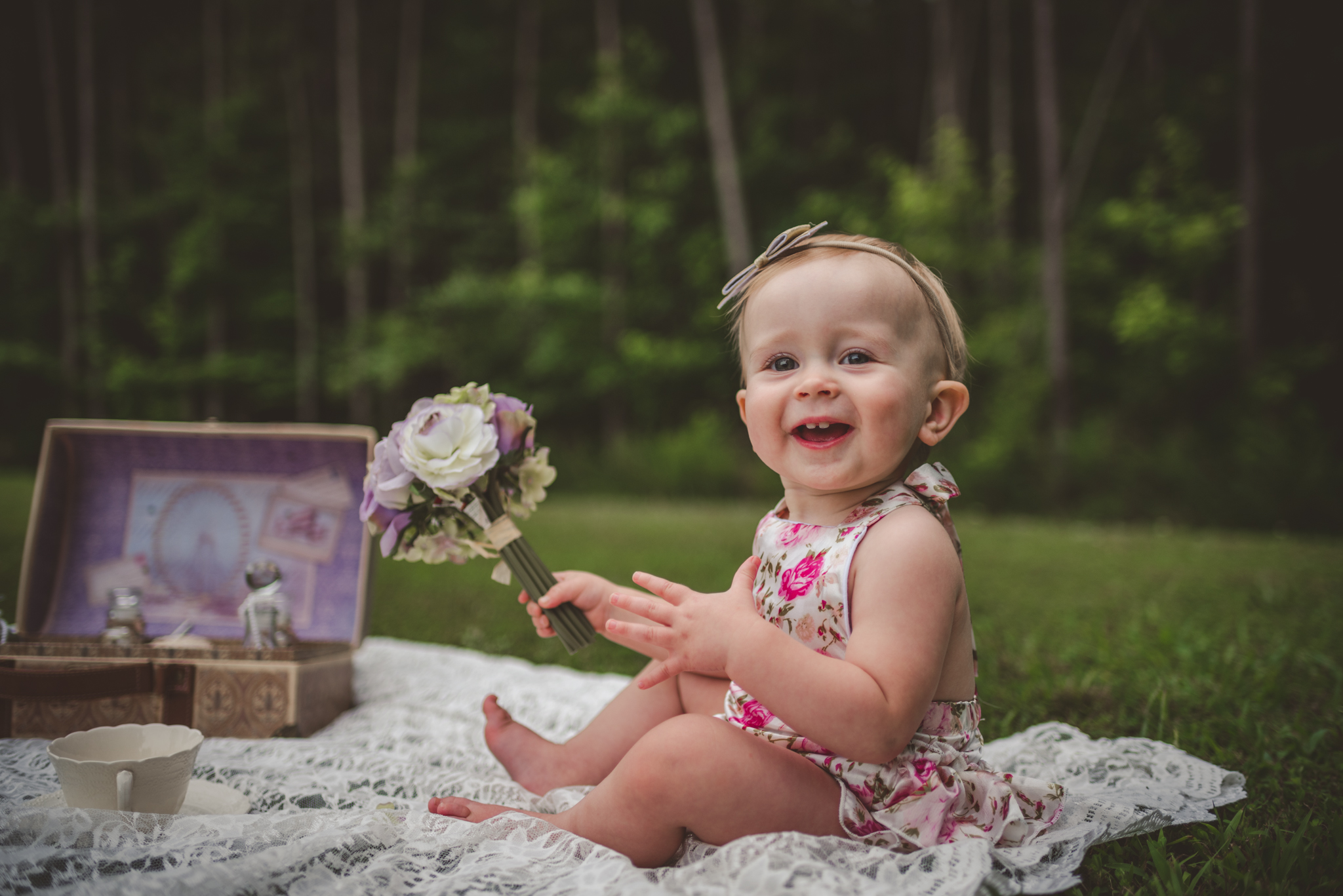 This little girl is sitting for her first birthday with vintage props from her parents wedding in Rolesville, North Carolina, image taken by Rose Trail Images.