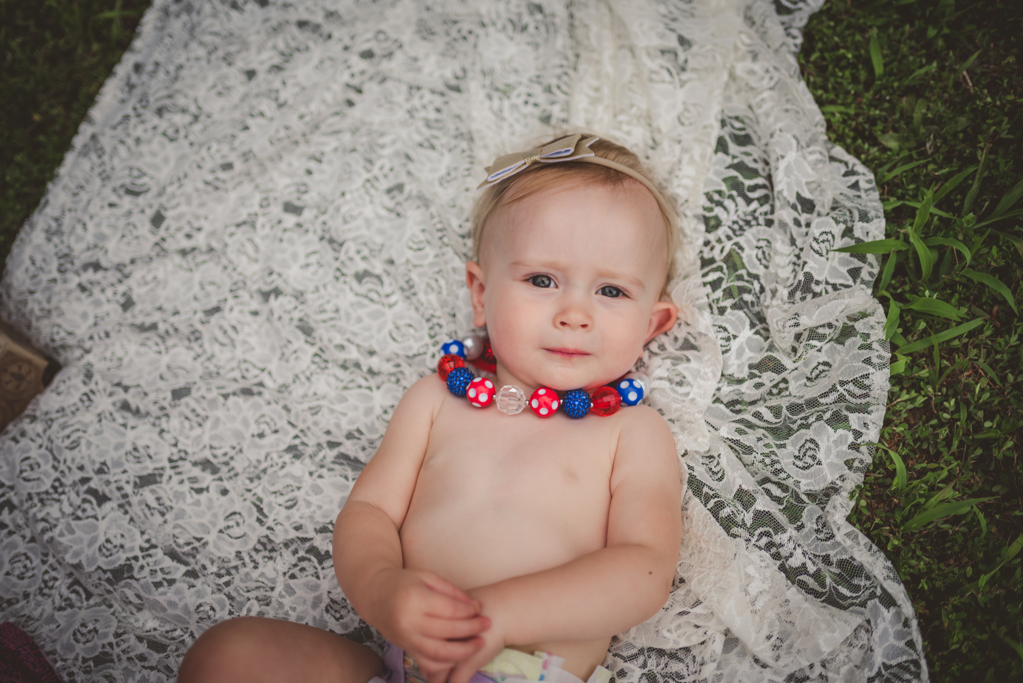 This little girl is getting ready for her fourth of July cake smash session with Rose Trail Images in Rolesville, North Carolina.