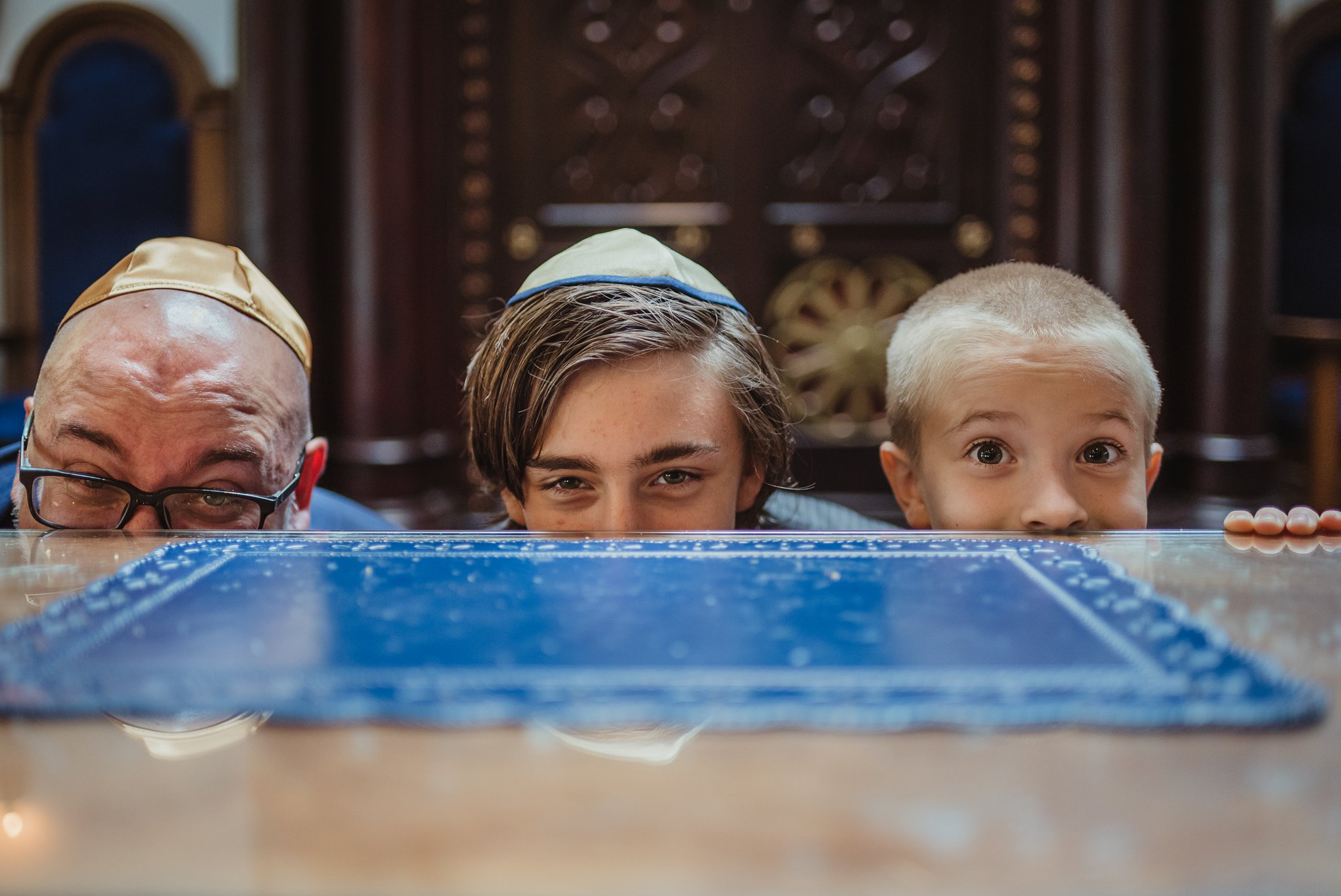 The bar mitzvah boy poses with his dad and brother for Rose Trail Images at Temple Beth Or in Raleigh, North Carolina.