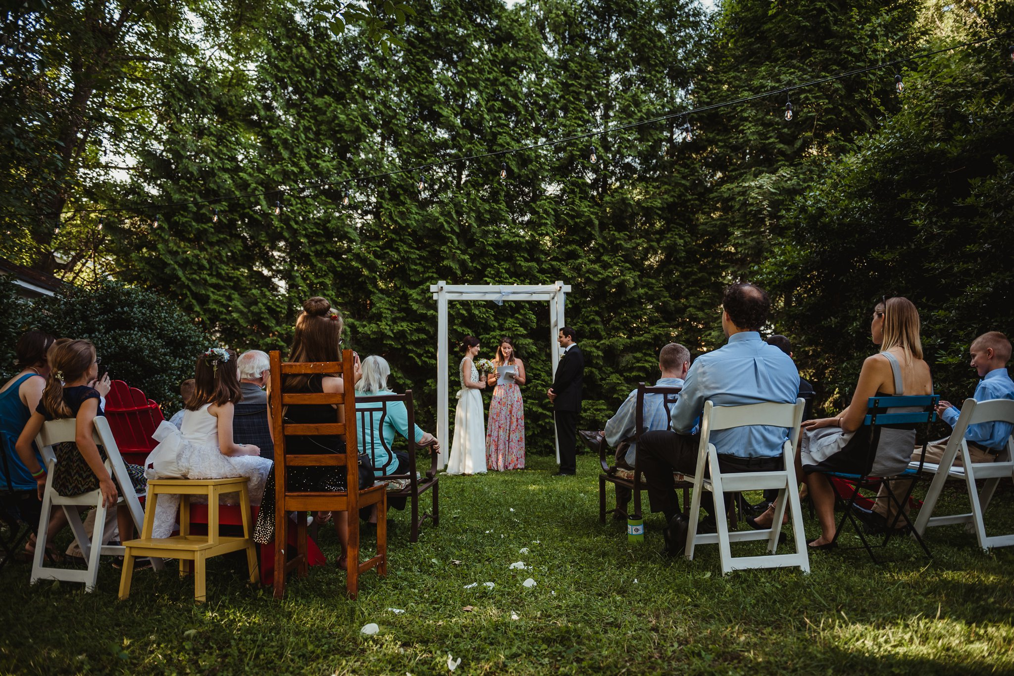 Betsy and Suliko's intimate wedding ceremony took place in their backyard in downtown Raleigh, North Carolina, photo by Rose Trail Images.