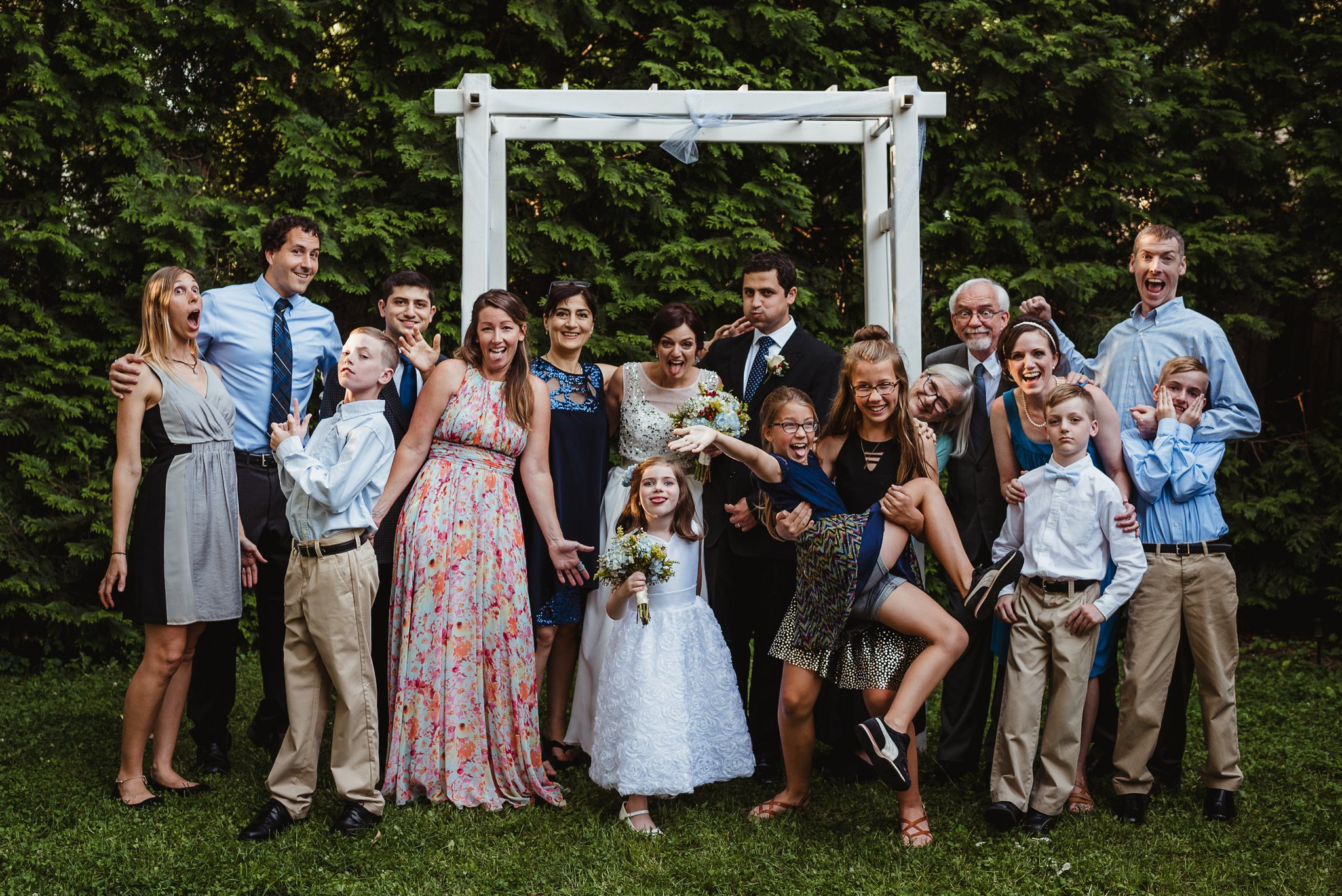 The bride and groom took pictures with all of their guests after their intimate wedding ceremony that took place in their backyard in downtown Raleigh, North Carolina, photo by Rose Trail Images.