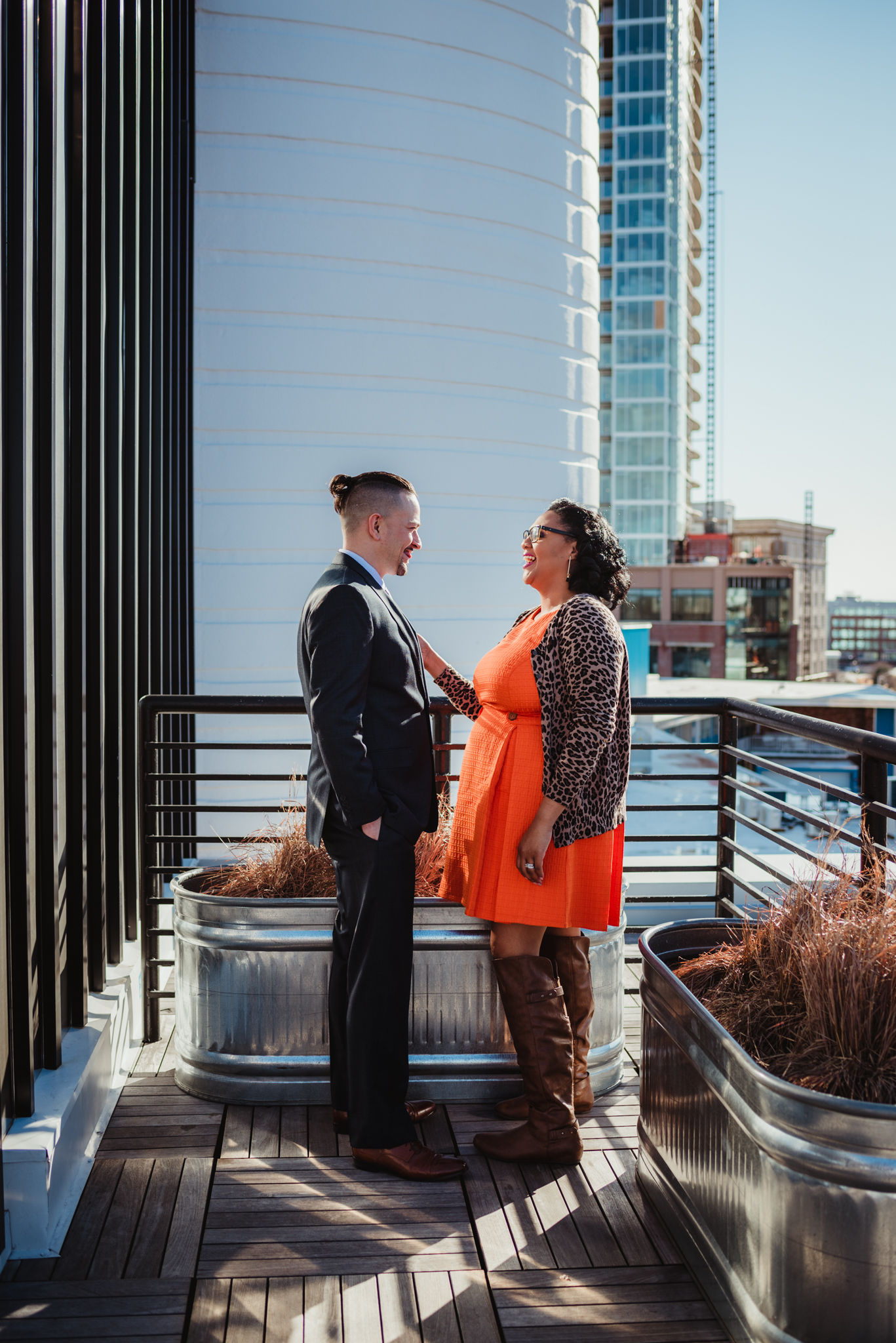 The husband and wife pose together for Rose Trail Images on the rooftop of the Durham Hotel in Durham, North Carolina.