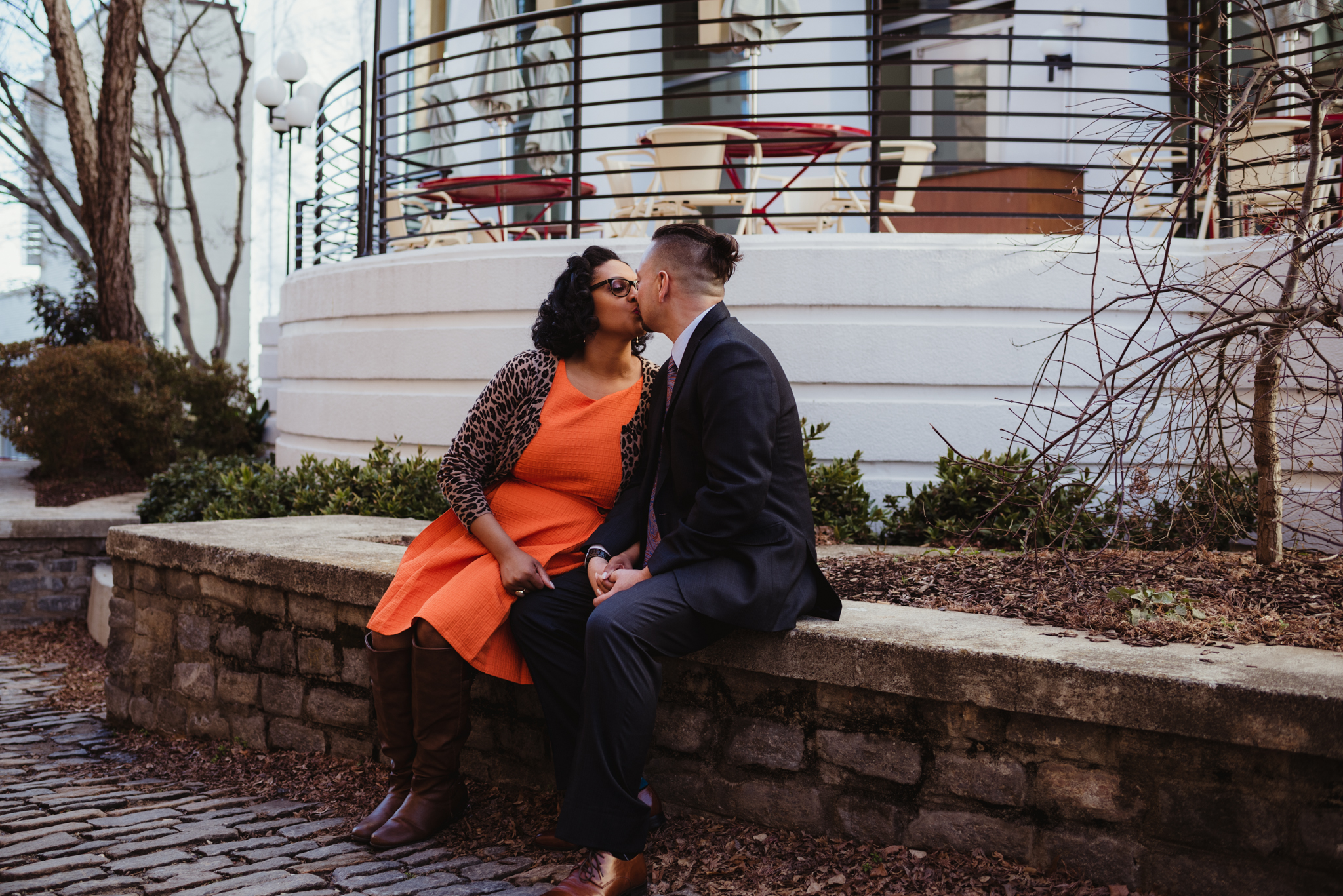 The husband and wife kiss outside of The Durham Hotel in Durham, North Carolina, image by Rose Trail Images.