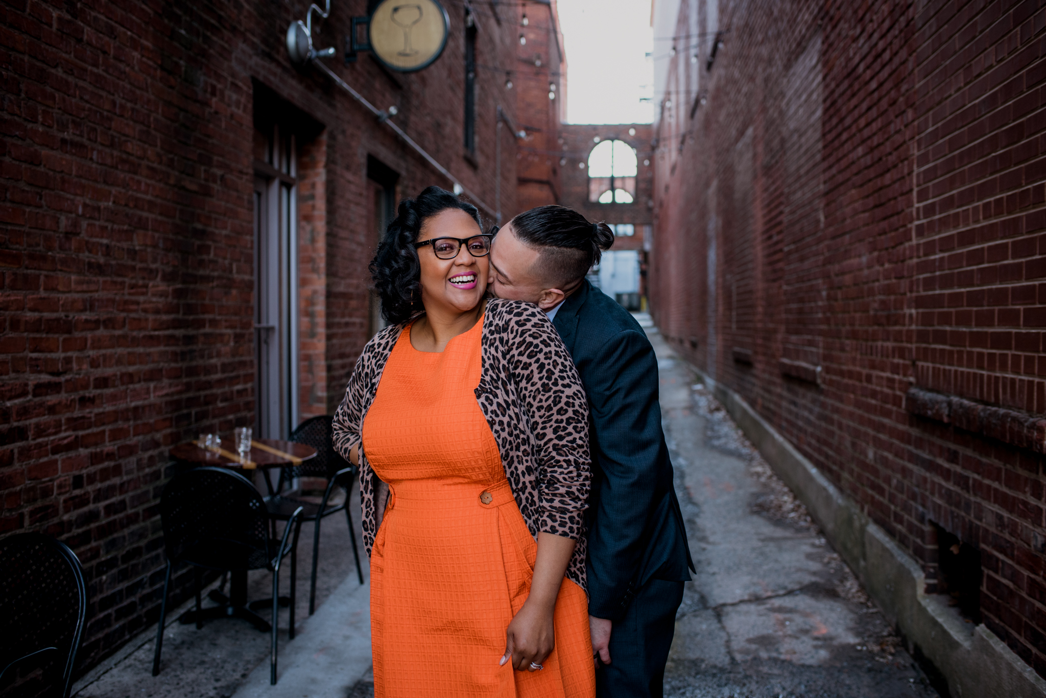 The husband and wife cuddle together in an alley way outside of The Durham Hotel in Durham, North Carolina, image by Rose Trail Images.