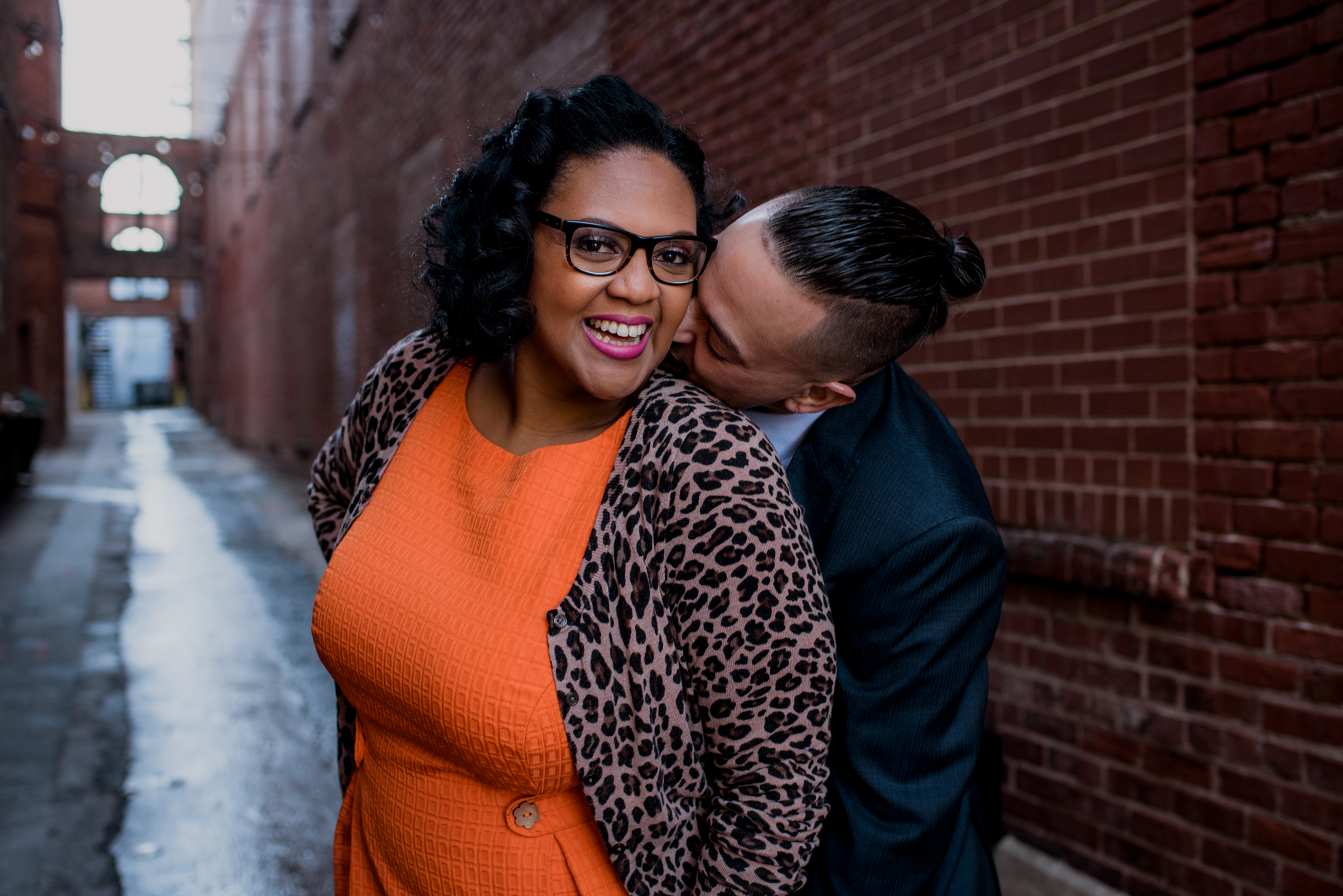 The husband and wife pose together in an alley way outside of The Durham Hotel in Durham, North Carolina, image by Rose Trail Images.