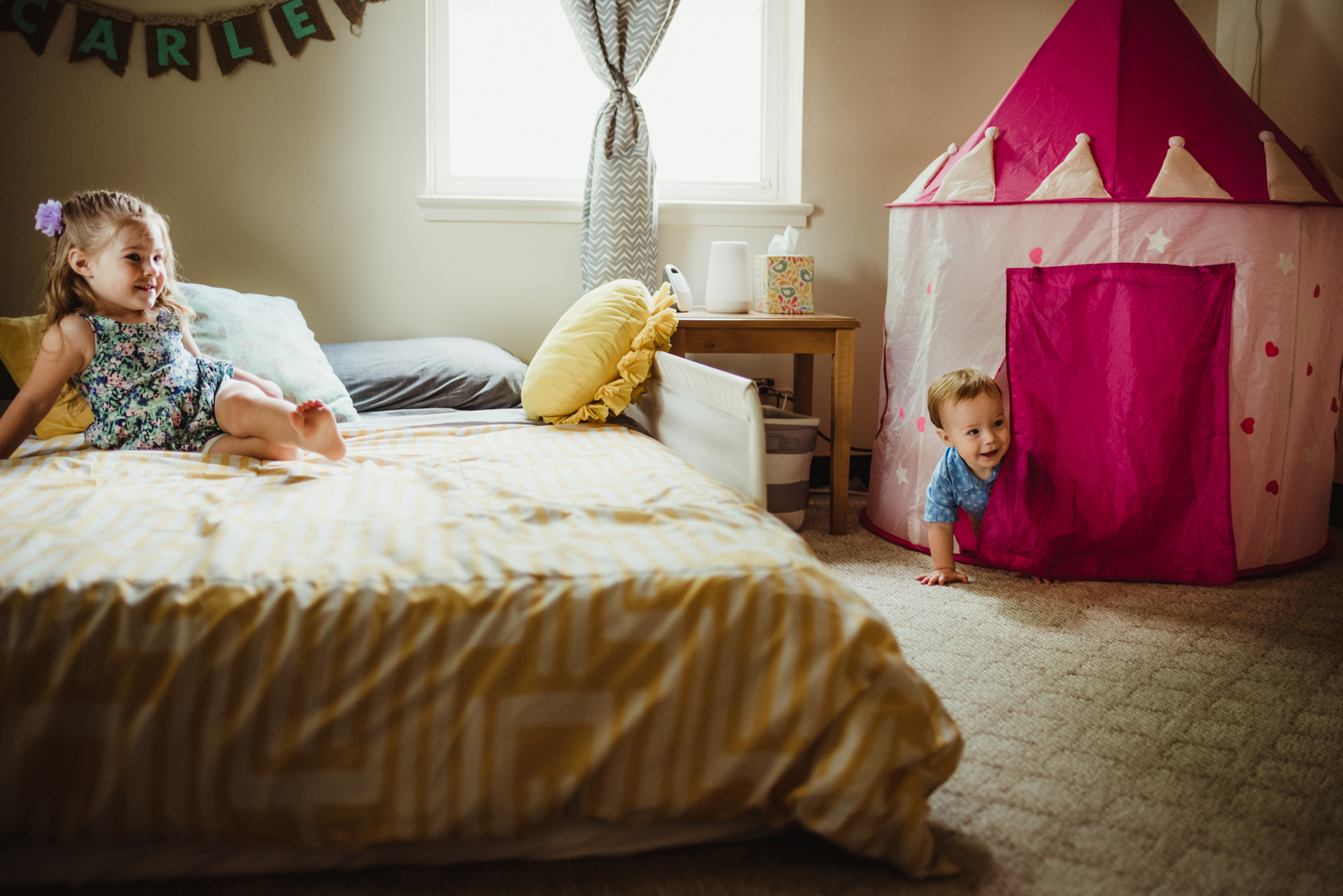 The kids play in the little girl's bedroom during their lifestyle session at home in Wake Forest with Rose Trail Images.