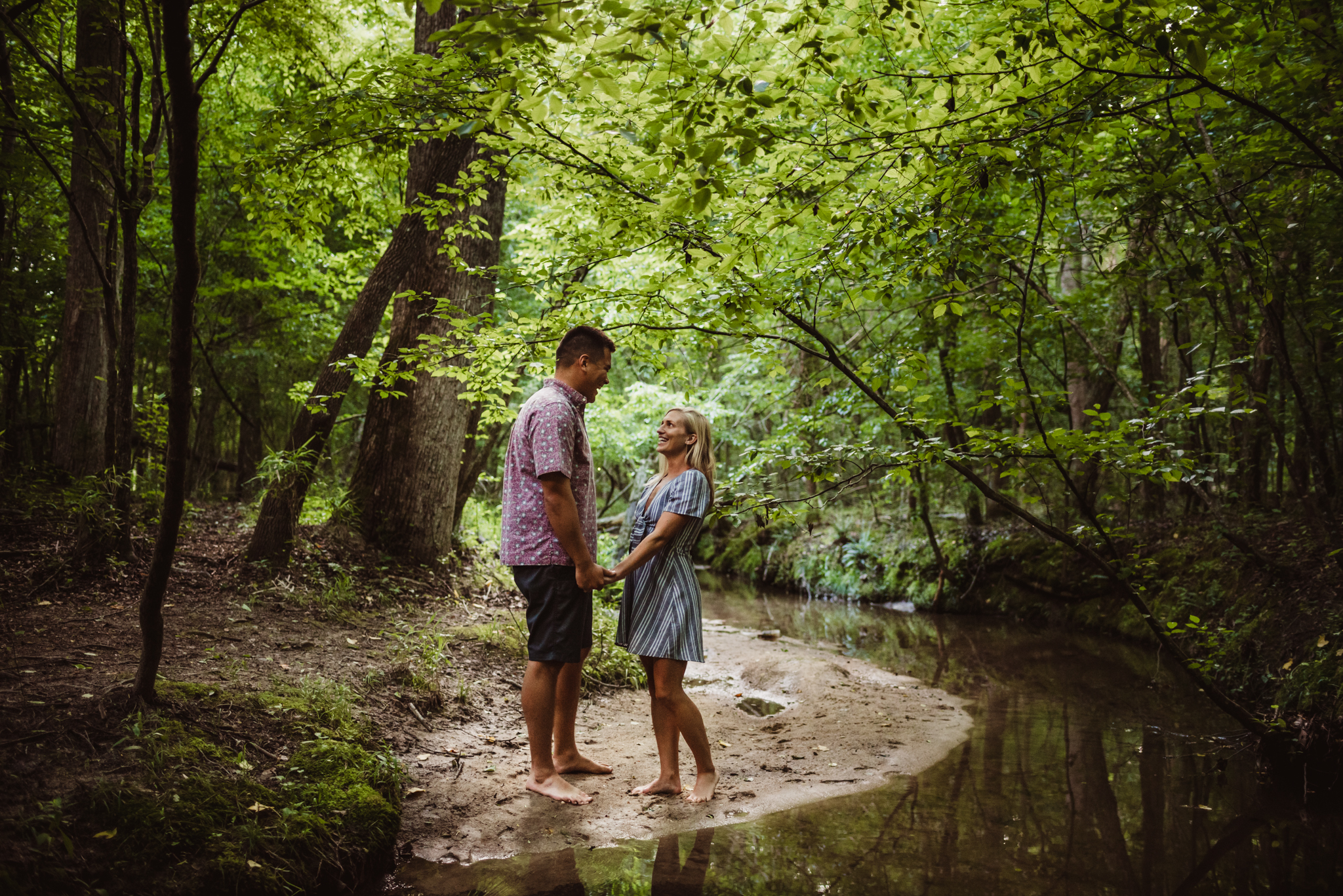 Kristin and Drew walked on the banks of the creek for their engagement pictures in Raleigh with Rose Trail Images.