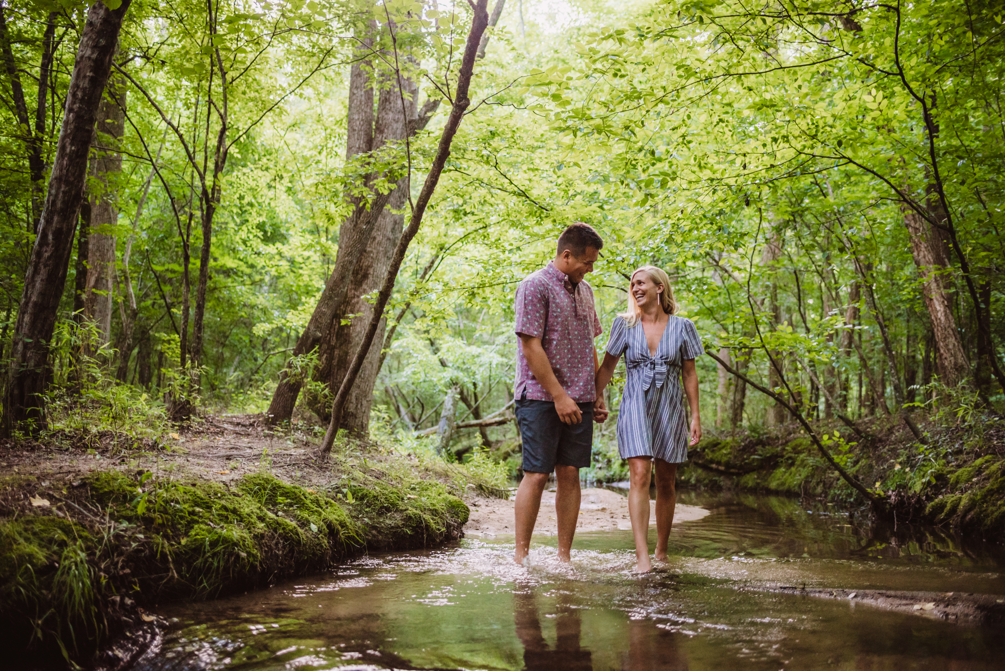 Kristin and Drew walked in the creek for their engagement pictures in Raleigh with Rose Trail Images.