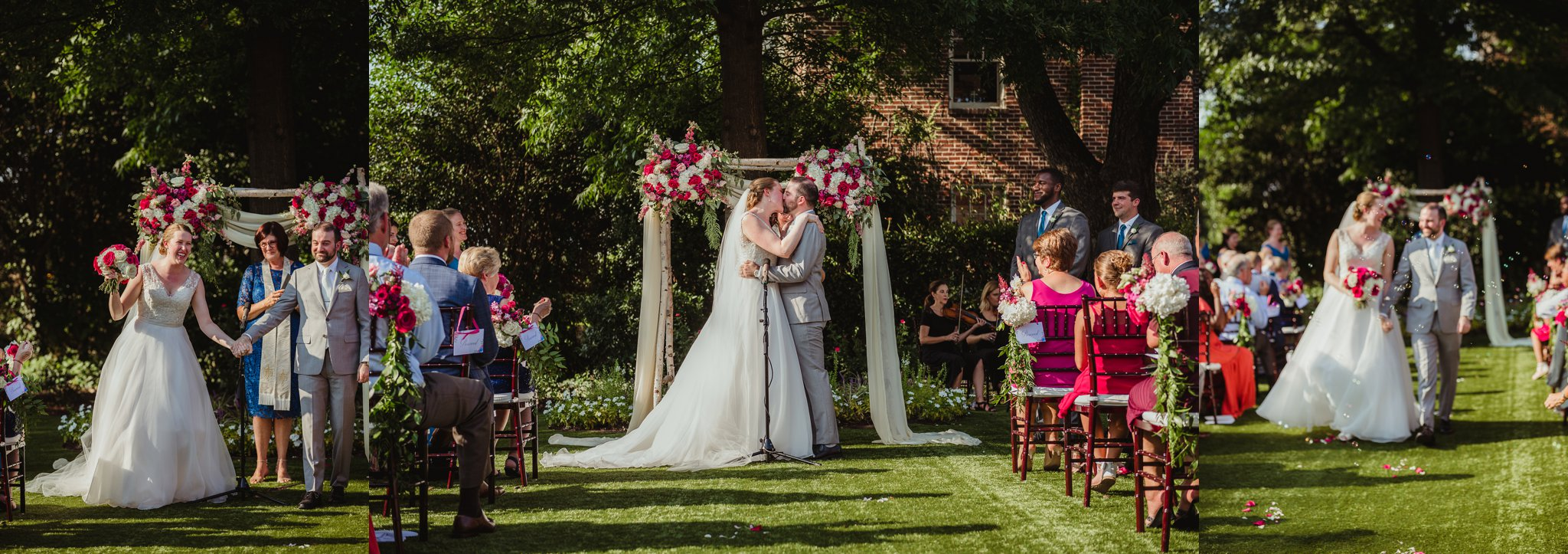 The bride and groom exchange a first kiss during their wedding ceremony at the Merrimon Wynne in Raleigh, photos by Rose Trail Images.