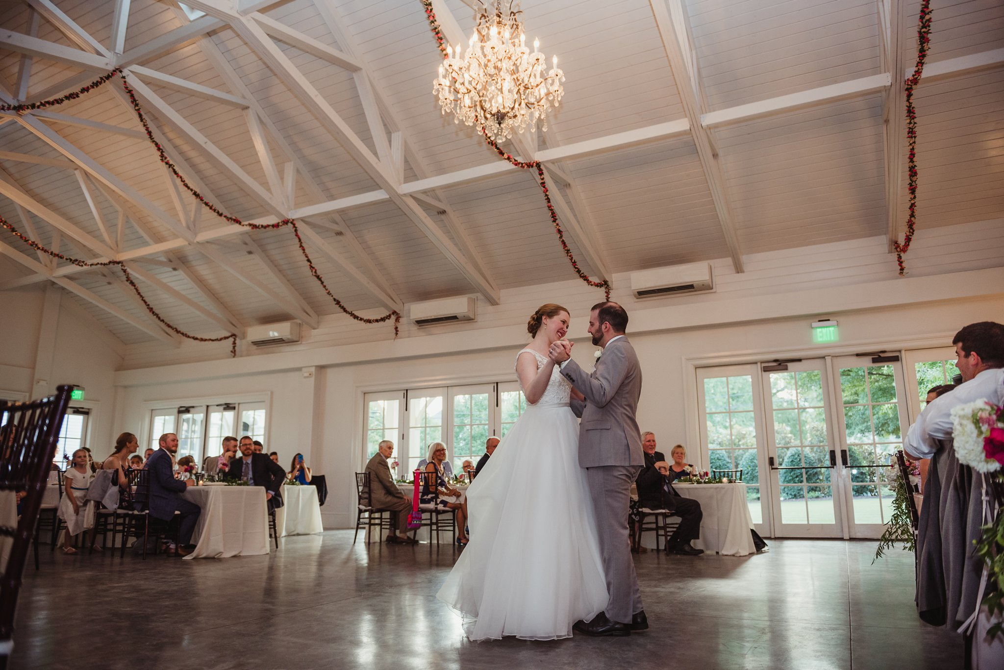 The bride and groom share a first dance during their wedding reception at the Merrimon Wynne in Raleigh, photos by Rose Trail Images.