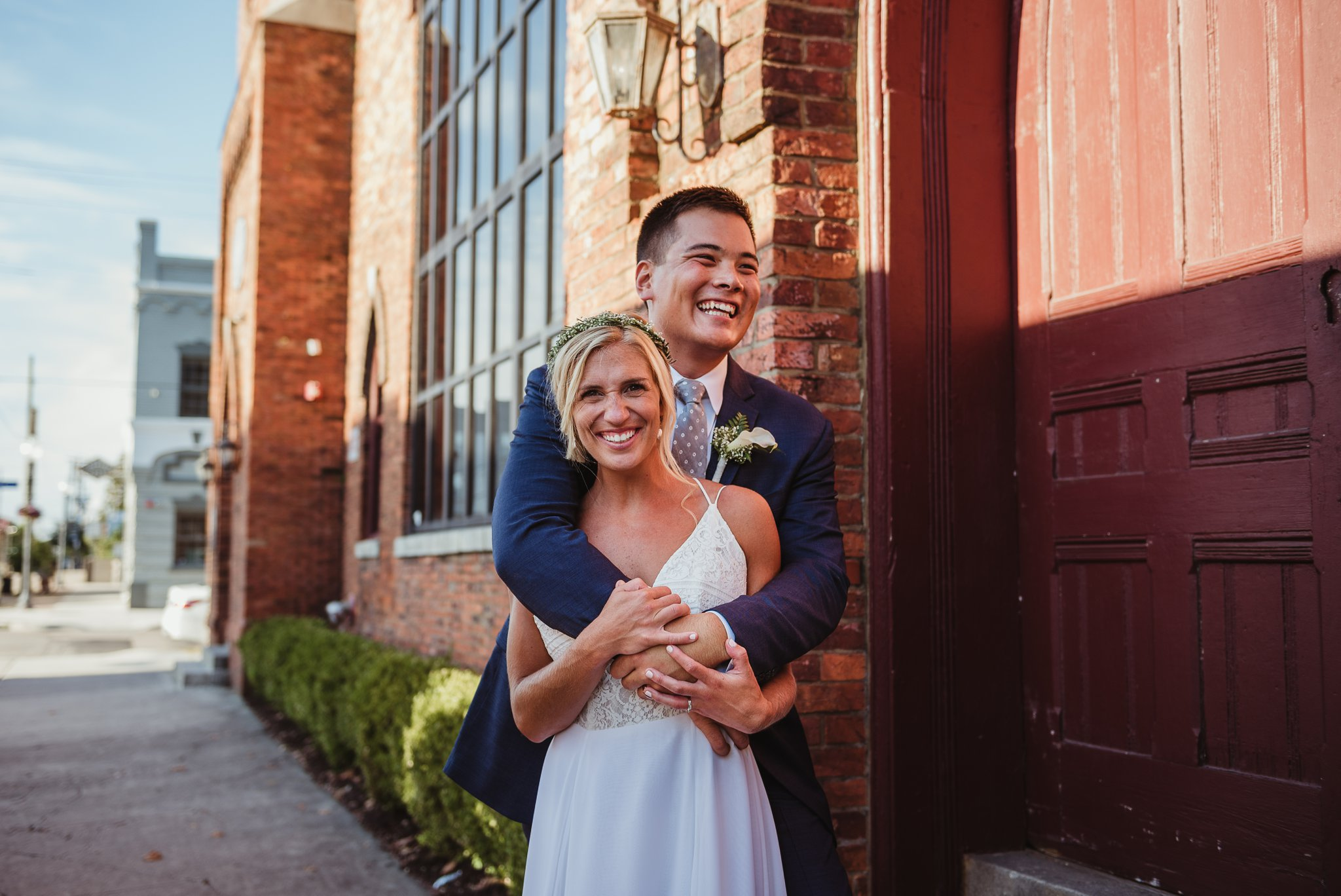 The bride and groom pose for Rose Trail Images after their wedding ceremony in Wilmington, North Carolina.