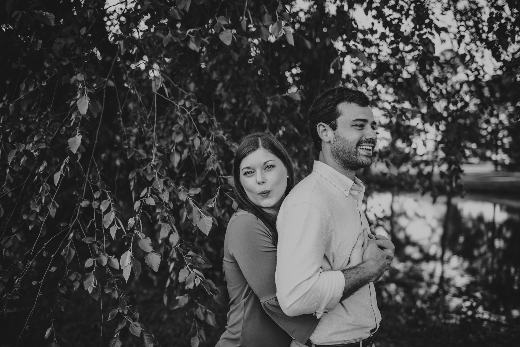 The bride and groom to be are silly together for their engagement pictures with Rose Trail Images at their family farm in Benson, North Carolina.