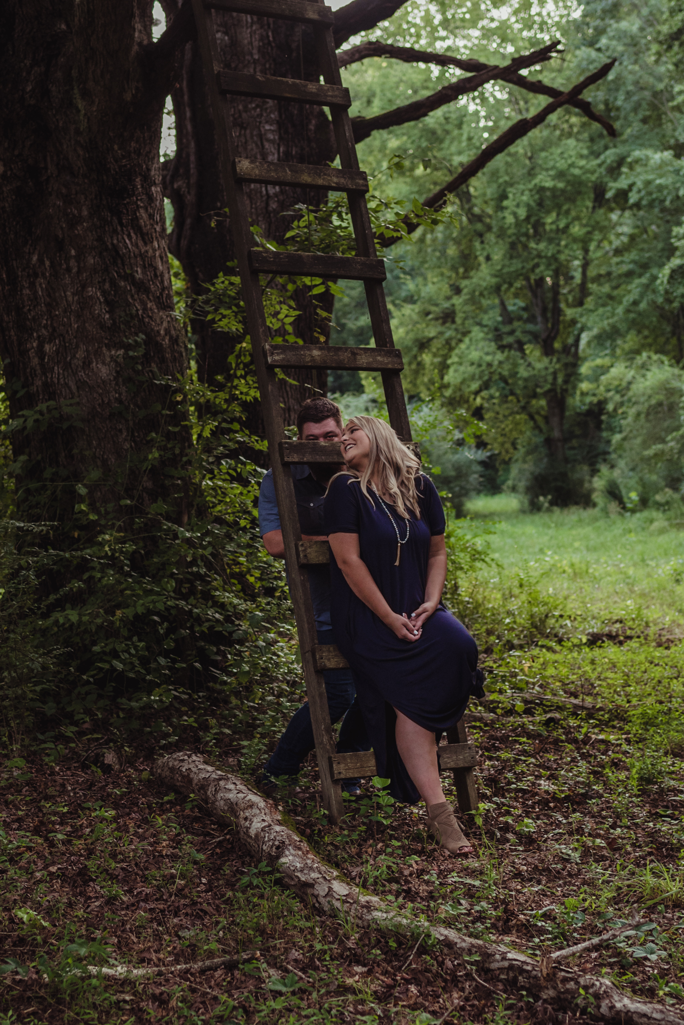 The future bride and groom get silly in the woods at the Warren Estate for their engagement pictures with Rose Trail Images.