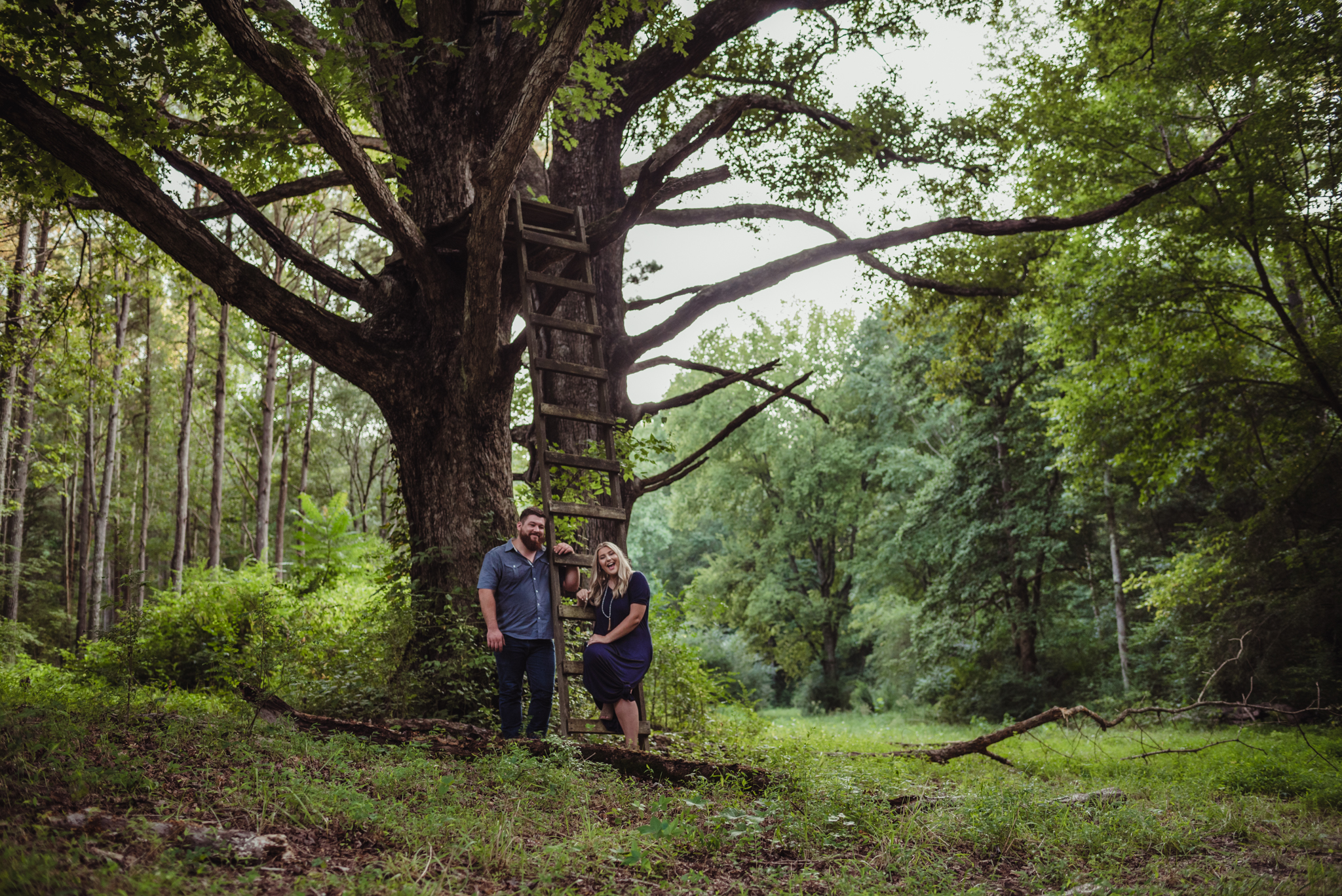 The future bride and groom strike a pose in the woods at the Warren Estate for their engagement pictures with Rose Trail Images.