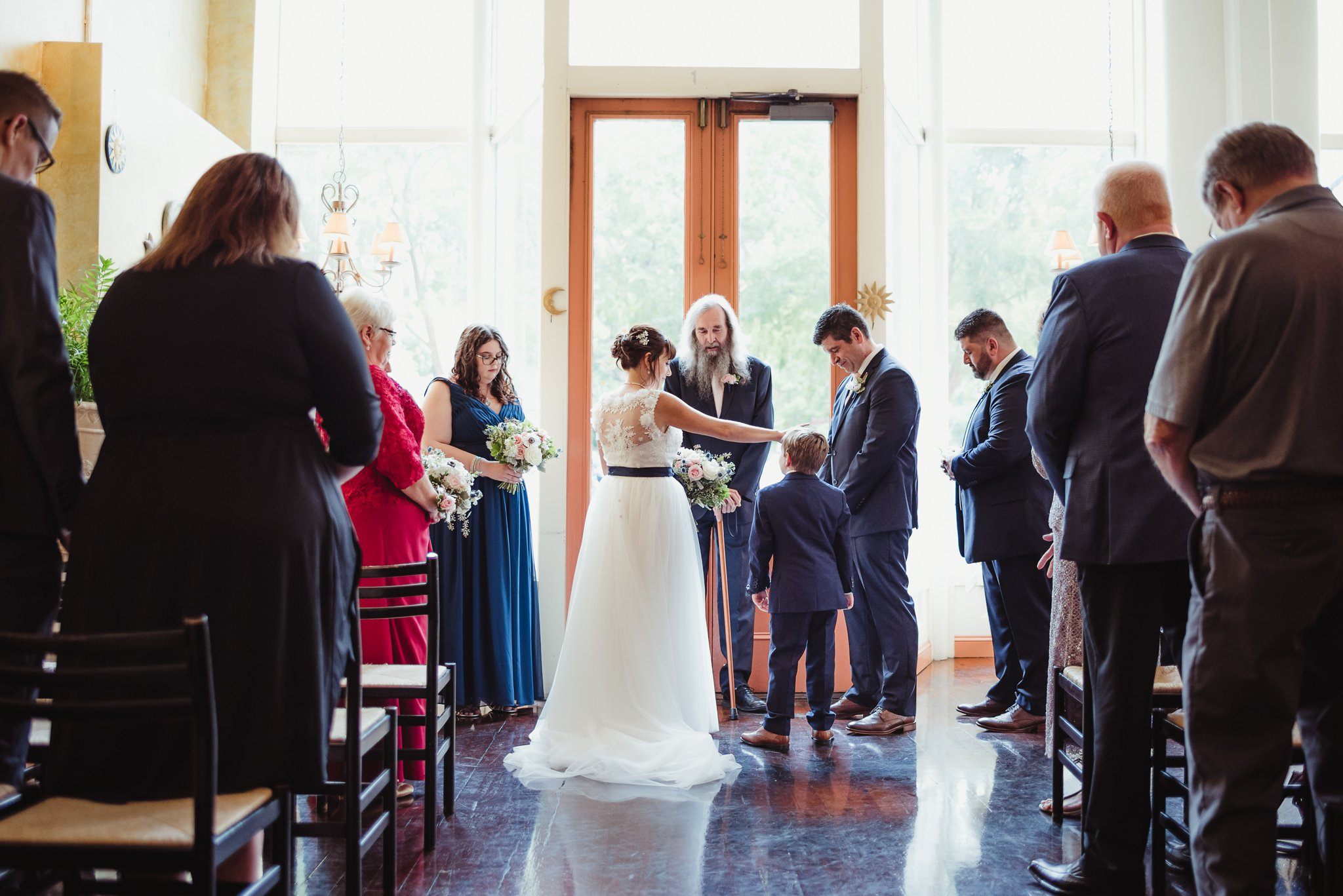 The bride was escorted down the aisle by her son during their wedding ceremony, pictures taken by Rose Trail Images at Caffe Luna in Raleigh, NC.