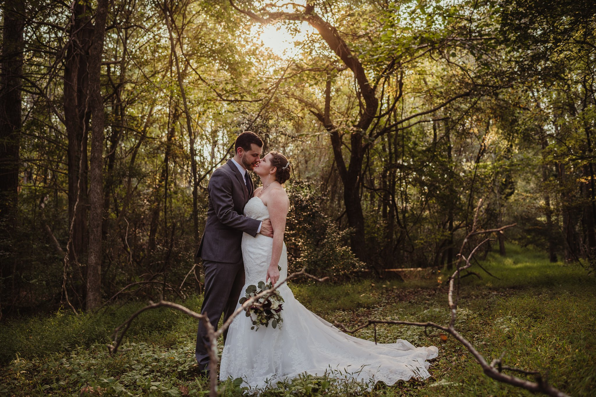 The bride and groom pose for outdoor portraits after their wedding ceremony in Raleigh, North Carolina, pictures by Rose Trail Images.