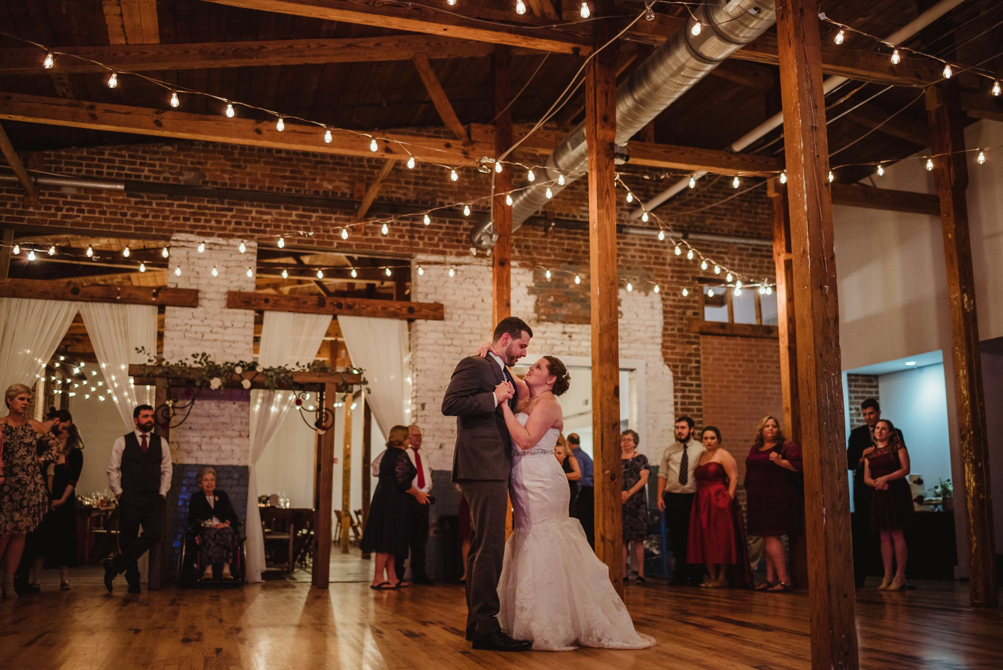 The bride and groom danced together for their first dance at their wedding reception in Raleigh, North Carolina, pictures by Rose Trail Images.
