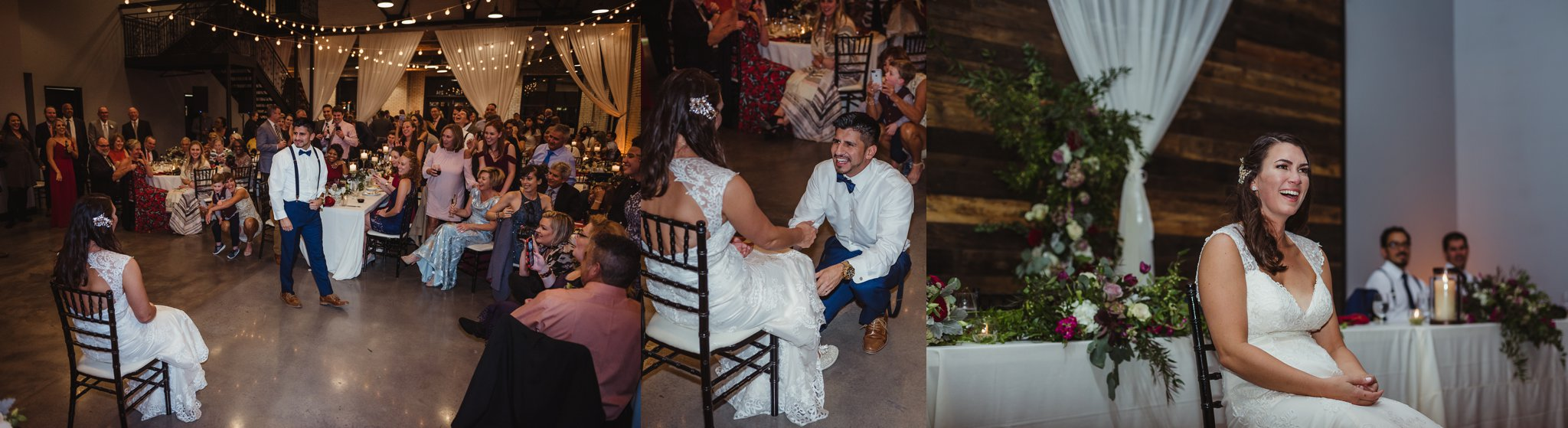 The groom does a dance and gets the garter from his bride at their wedding reception at Market Hall in downtown Raleigh, photos by Rose Trail Images.