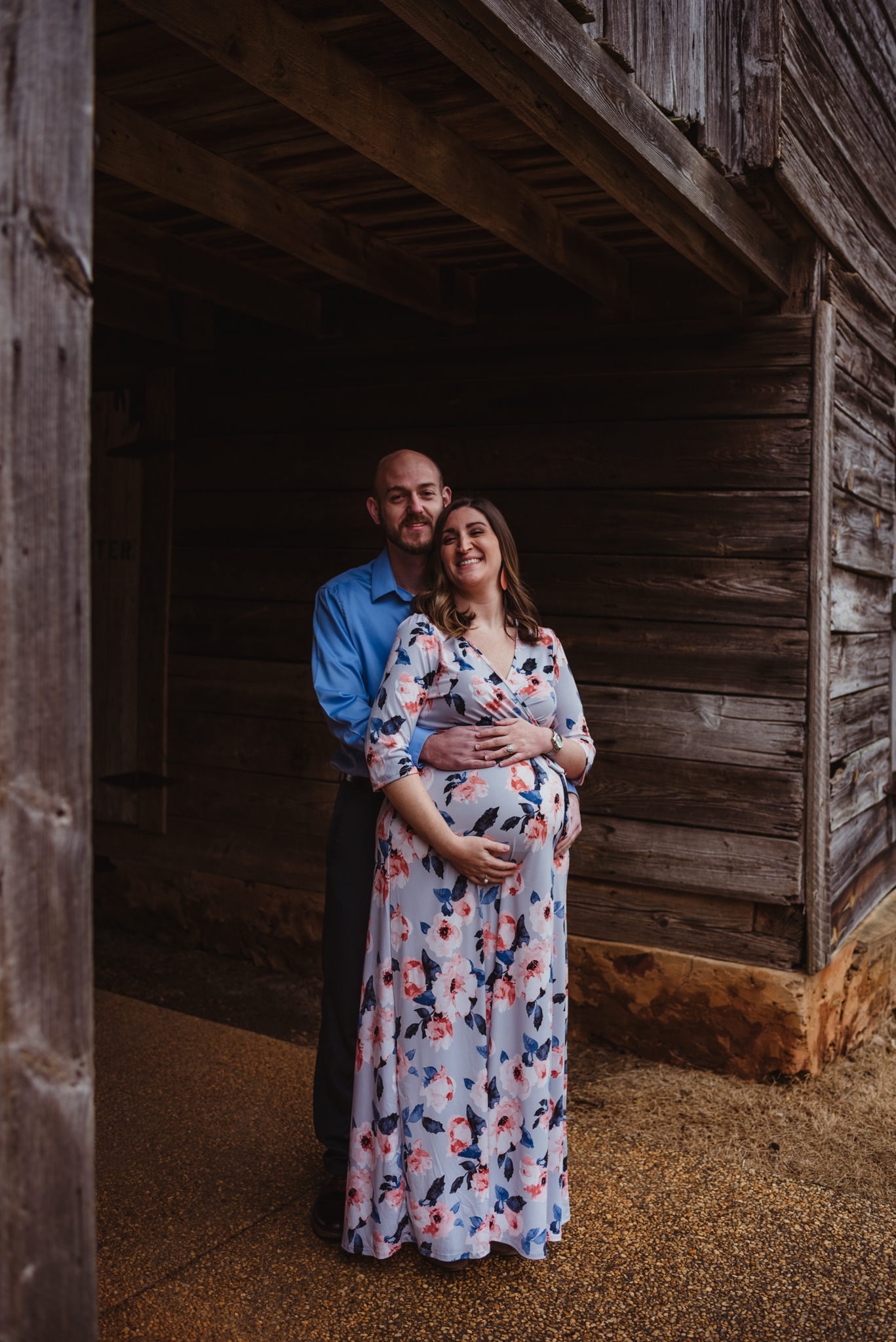 The parents to be cuddle under the old barn, picture taken by Rose Trail Images at Joyner Park in Wake Forest, NC.