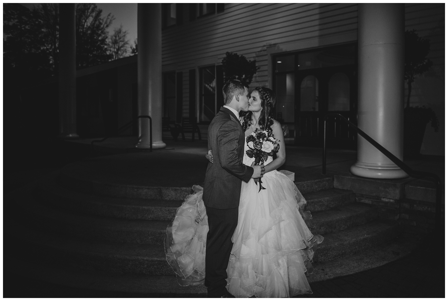 raleigh-wedding-photographer-photojournalism-black-and-white-kiss-1705-east-caitlyn-and-evan_0030.jpg