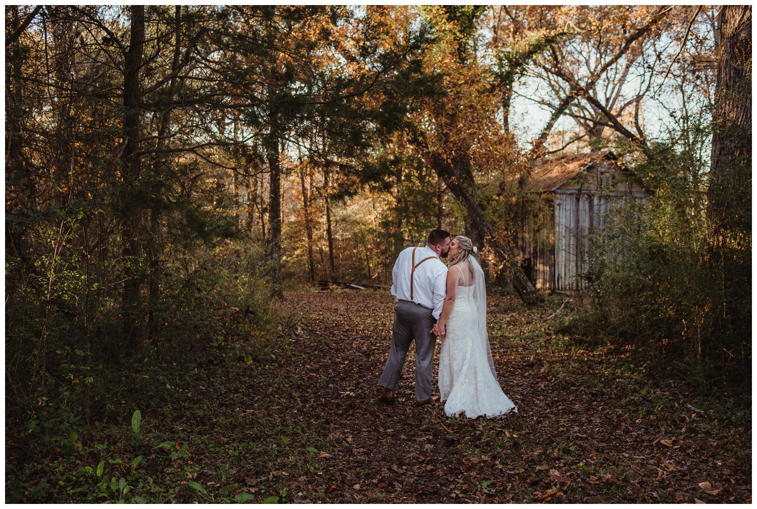 Kayla and Brian take a moment to kiss in the woods after their wedding ceremony at The Warren Estate, images by Rose Trail Images of Rolesville, NC.