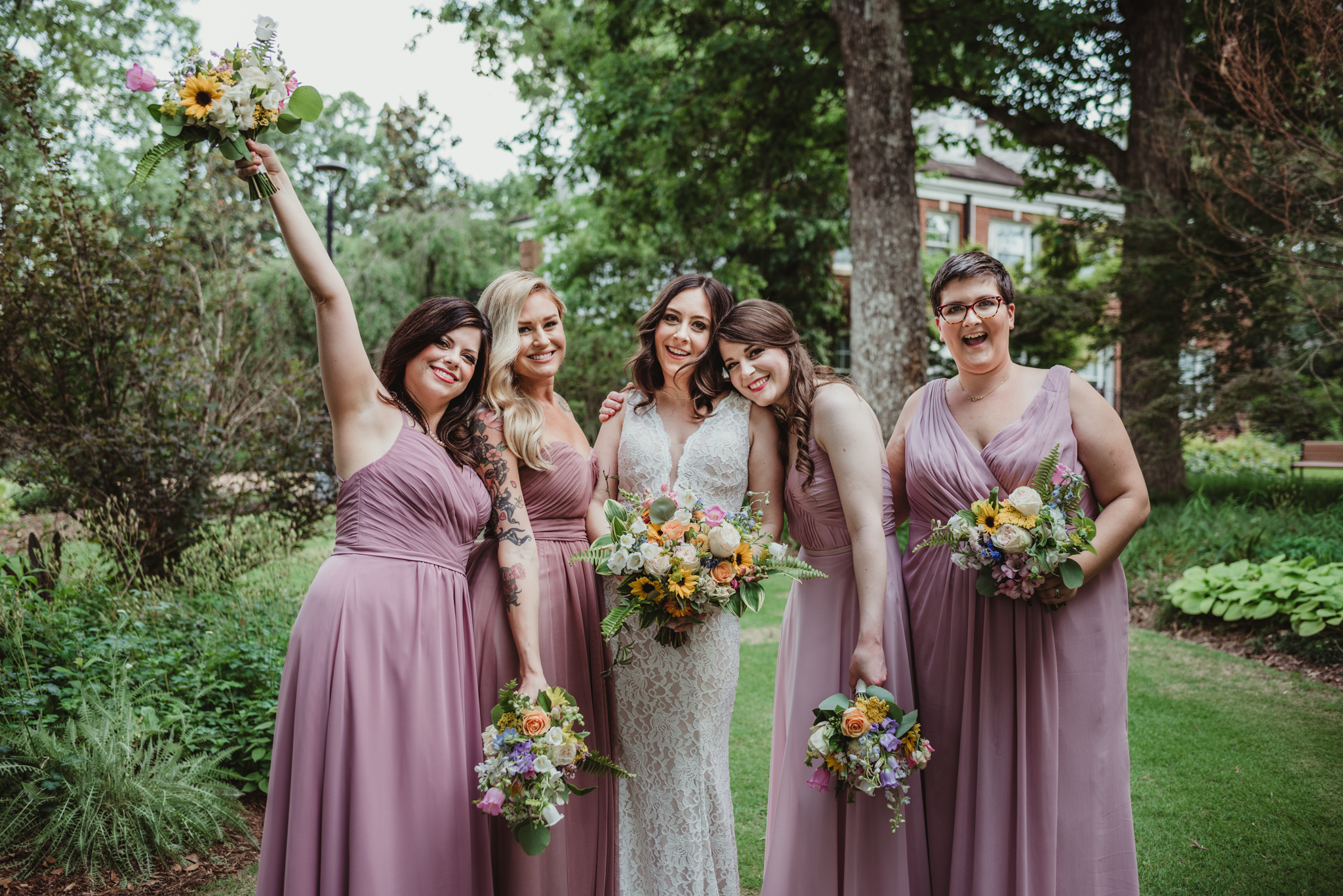 Raleigh-wedding-photographer-bride-with-her-bridesmaids-fred-fletcher-rose-trail-images.jpg