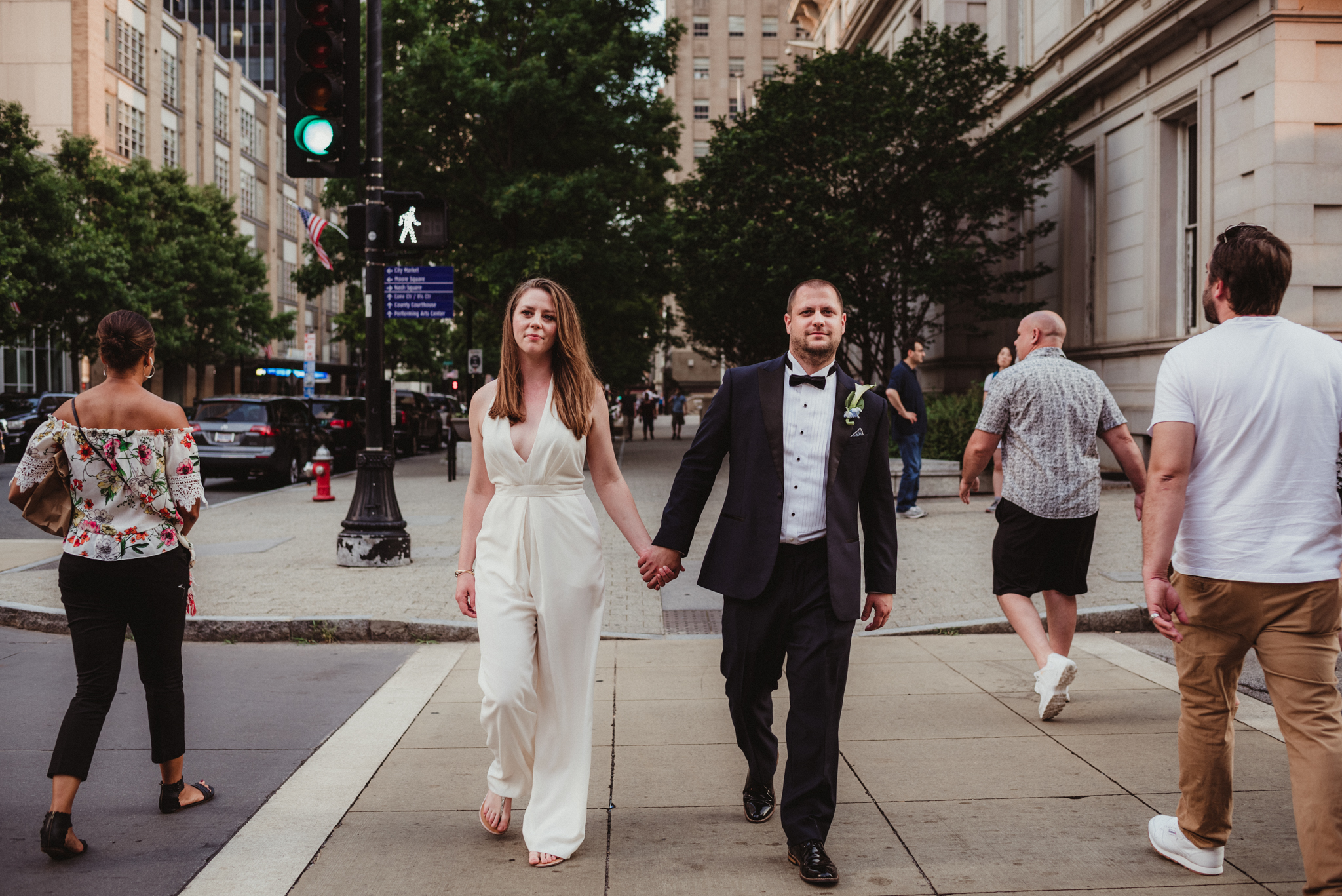 Raleigh-wedding-photographer-bride-and-groom-portraits-walk-in-downtown-rose-trail-images.jpg