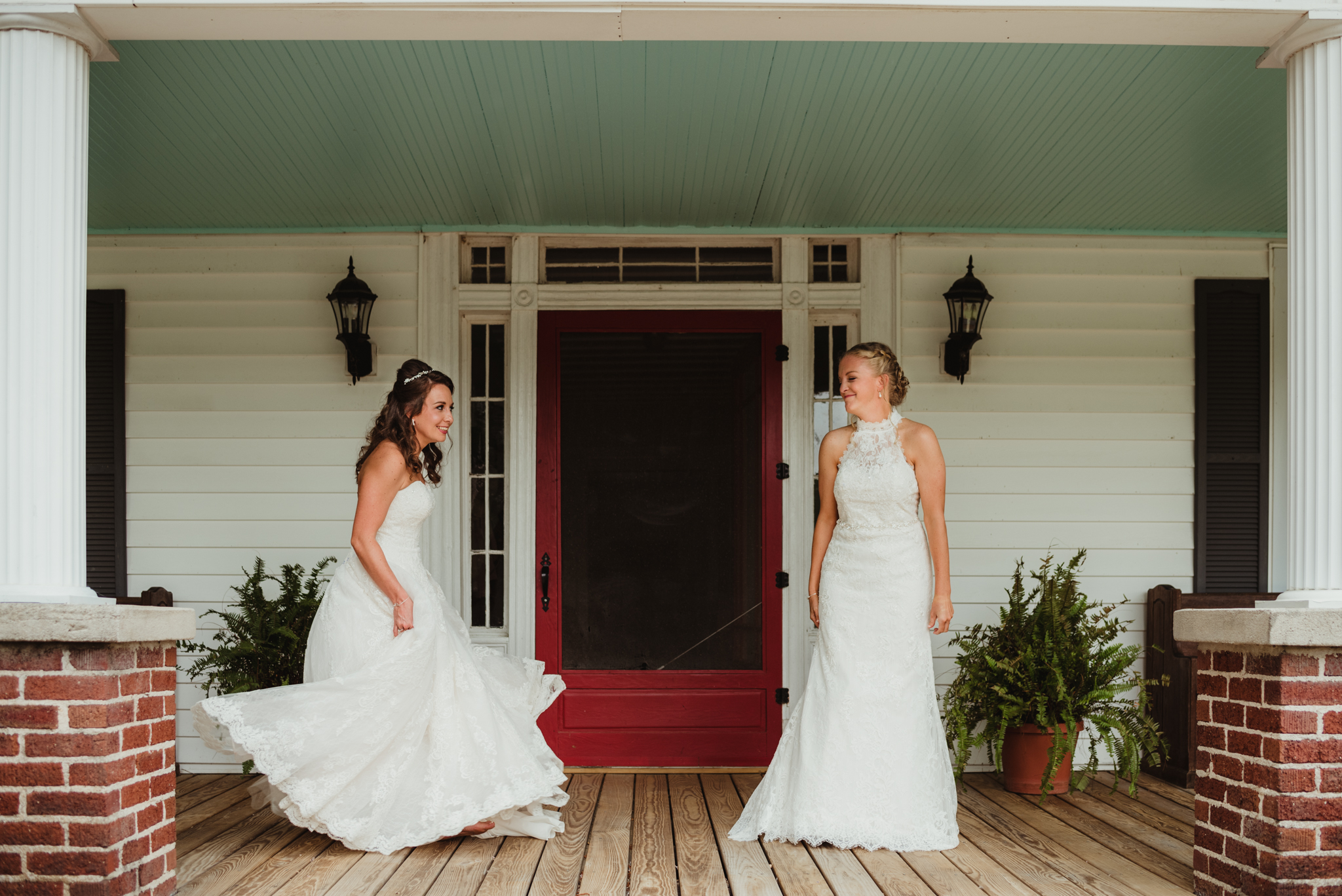 Raleigh-wedding-photographer-two-brides-first-look-porch-cedar-grove-acres-rose-trail-images.jpg