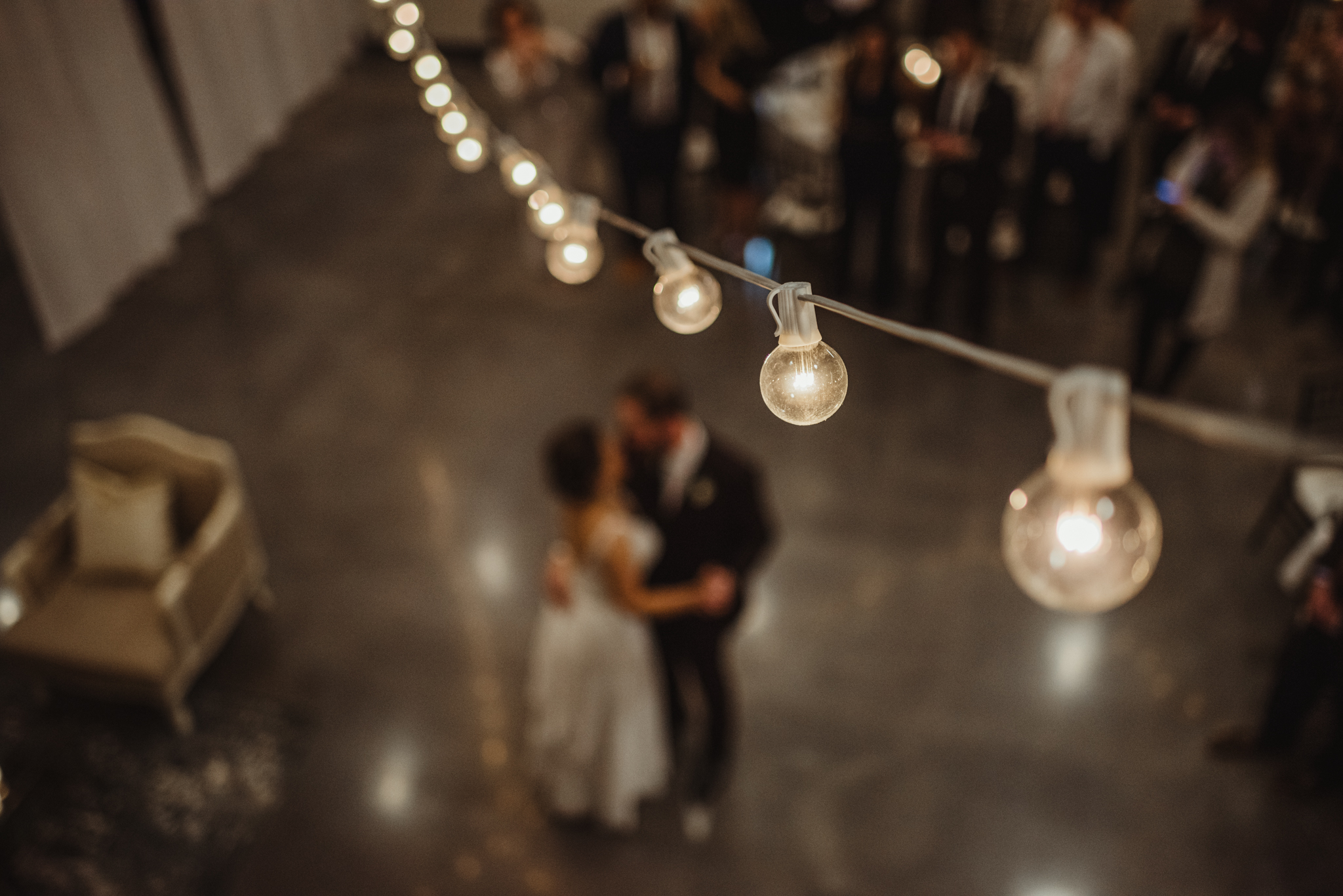 Raleigh-wedding-photographer-bride-and-groom-first-dance-market-hall-rose-trail-images.jpg
