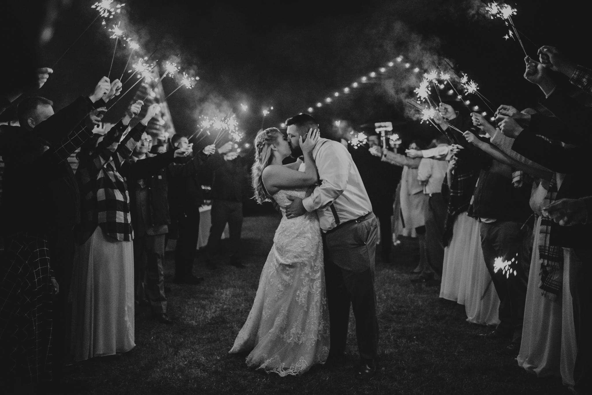 Raleigh-wedding-photographer-kiss-under-sparklers-rose-trail-images.jpg
